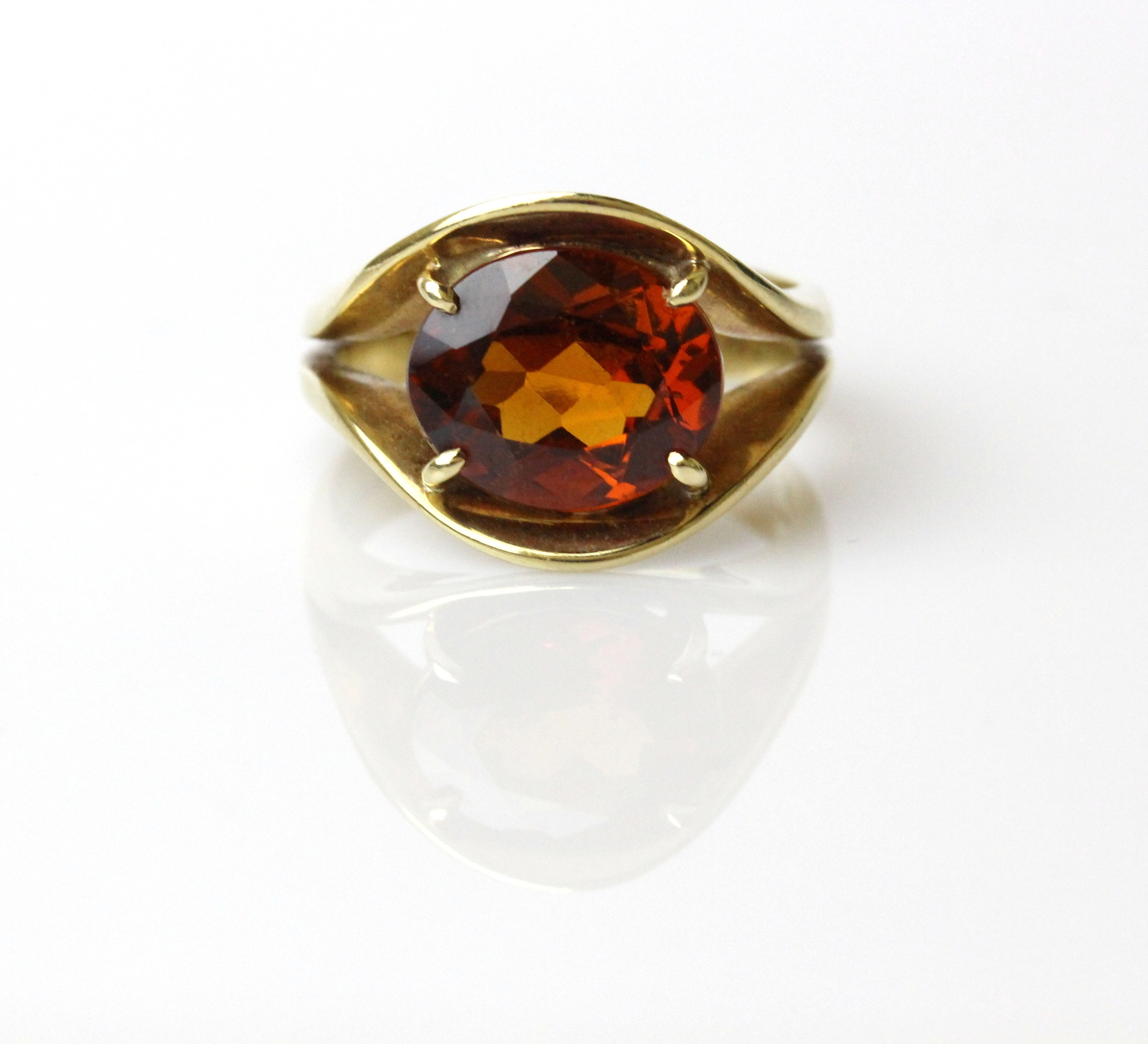 Yellow gold ring set with hessonite garnet.