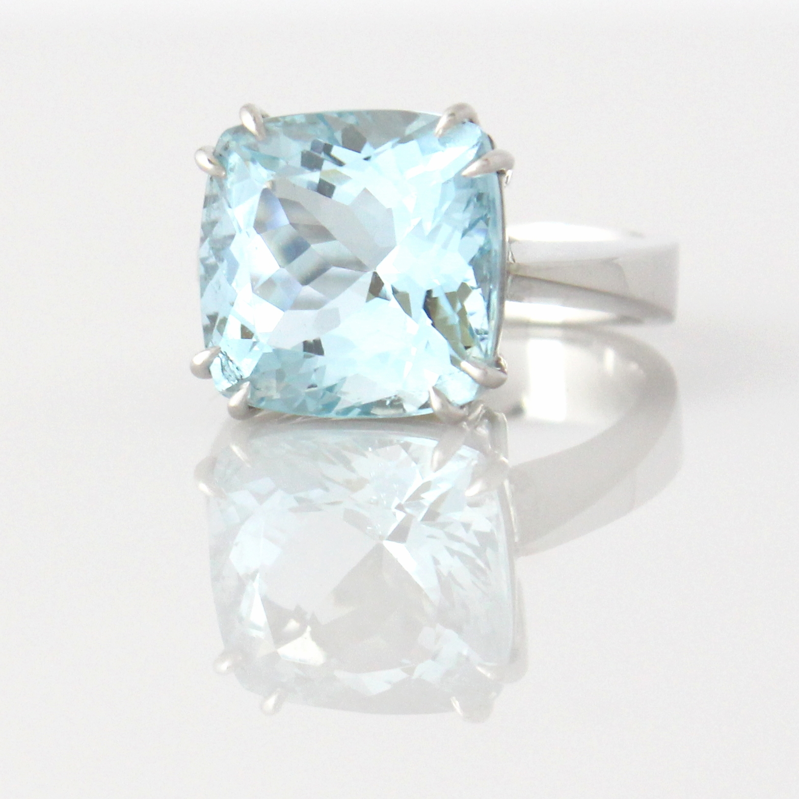 Double claw set aquamarine in white gold ring.