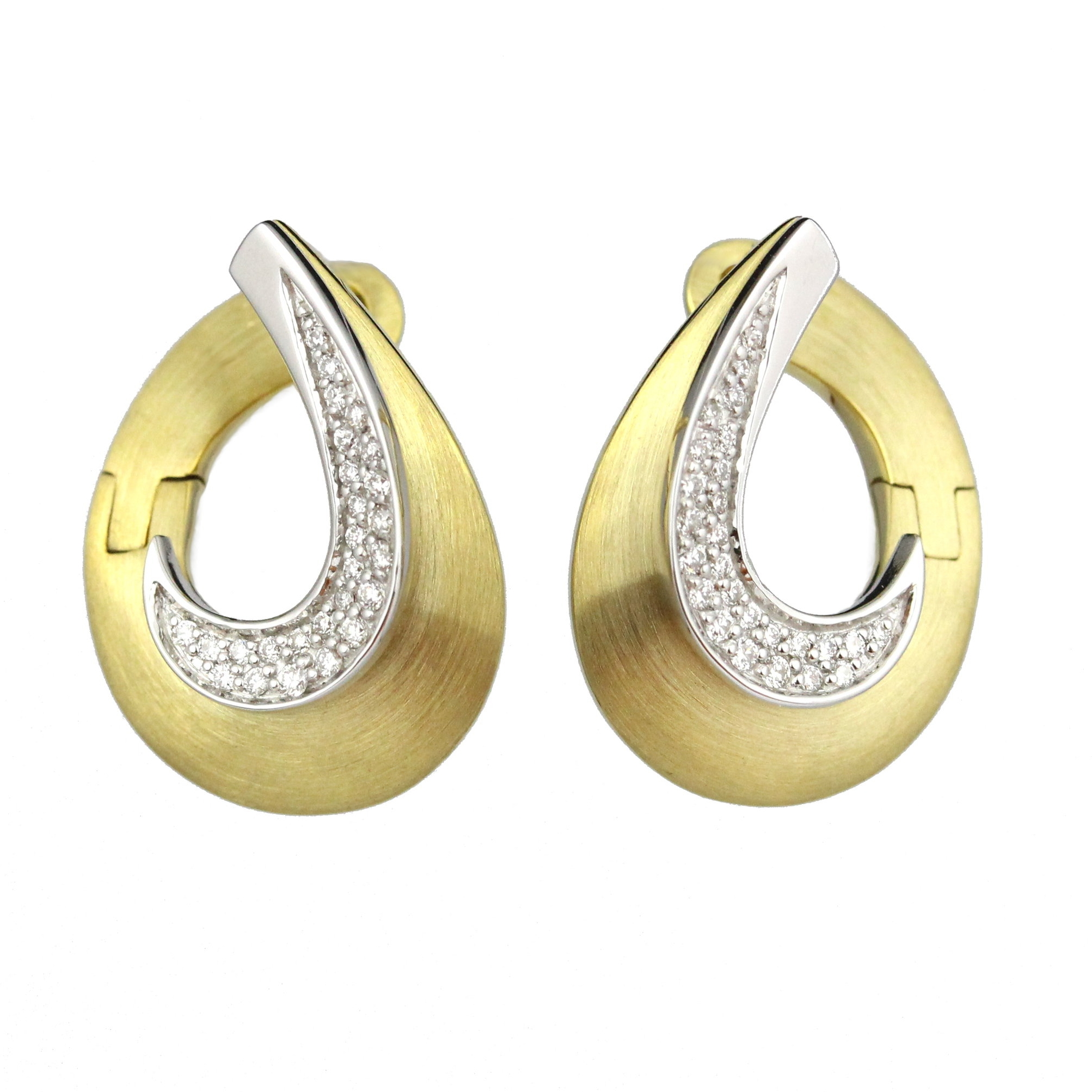 Diamonds set in white gold with brushed finish yellow gold earrings.