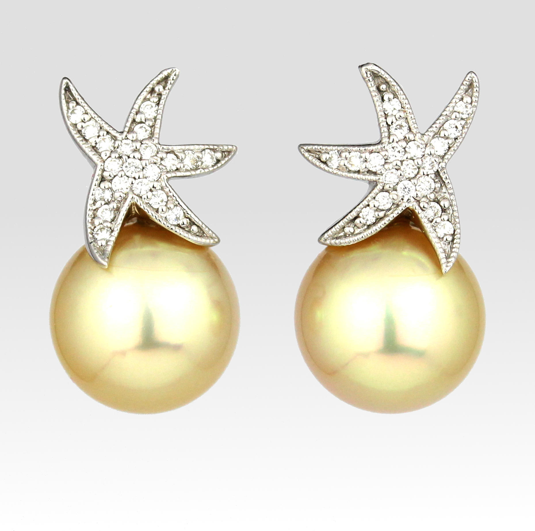 Golden pearls with diamond set white gold starfish studs.