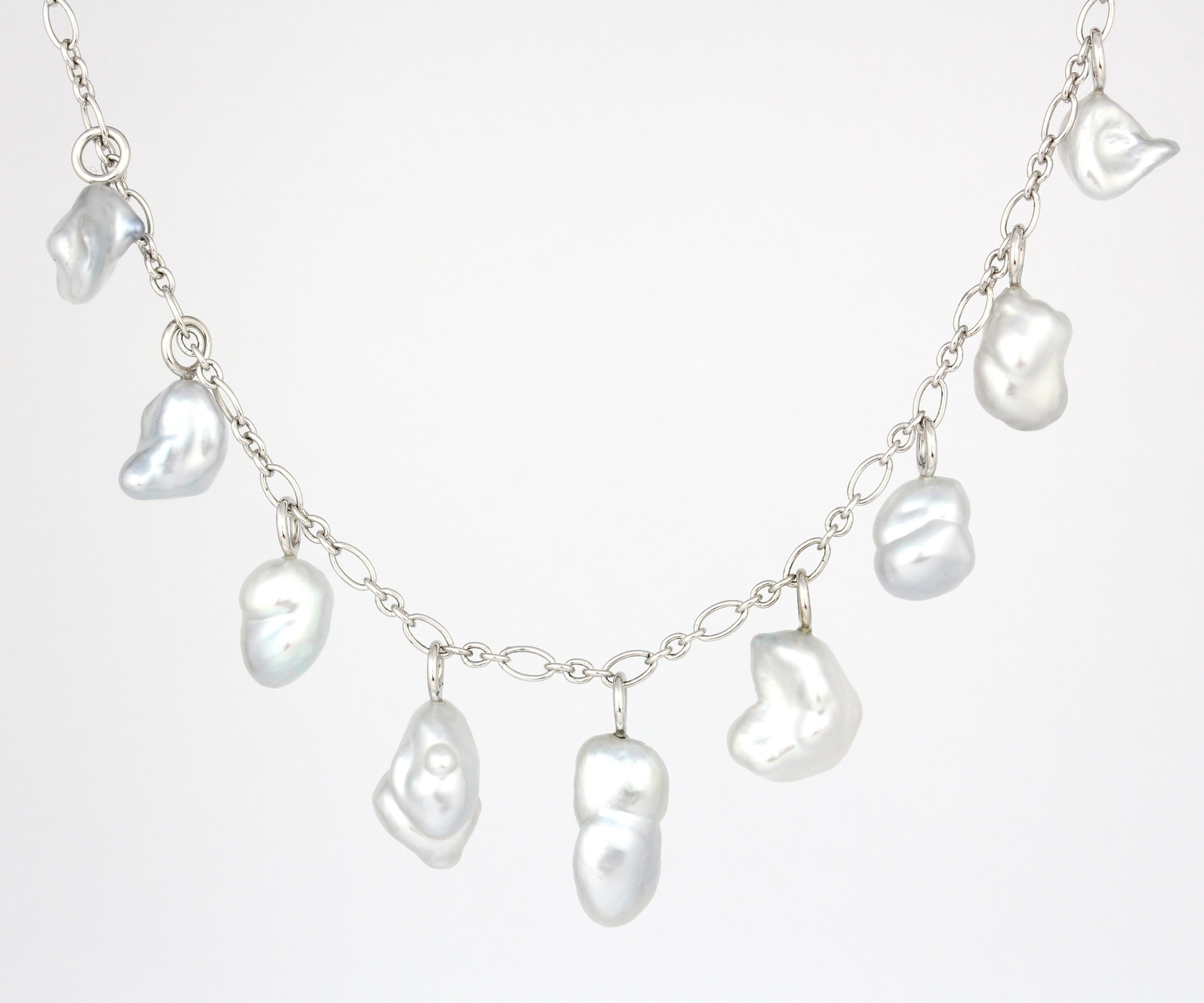 Keshi pearls on white gold chain.