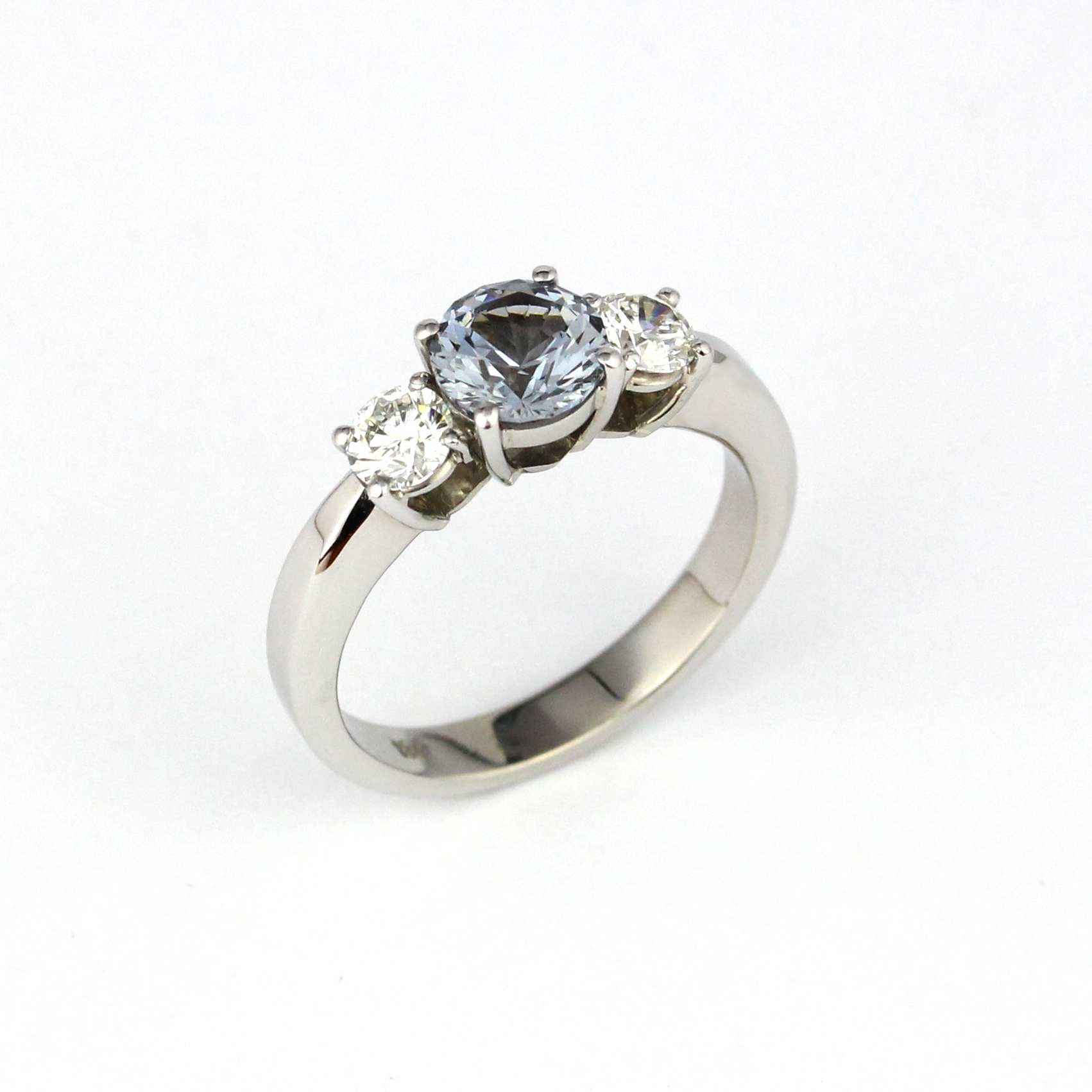 Grey spinel and diamond shoulders claw set in white gold.