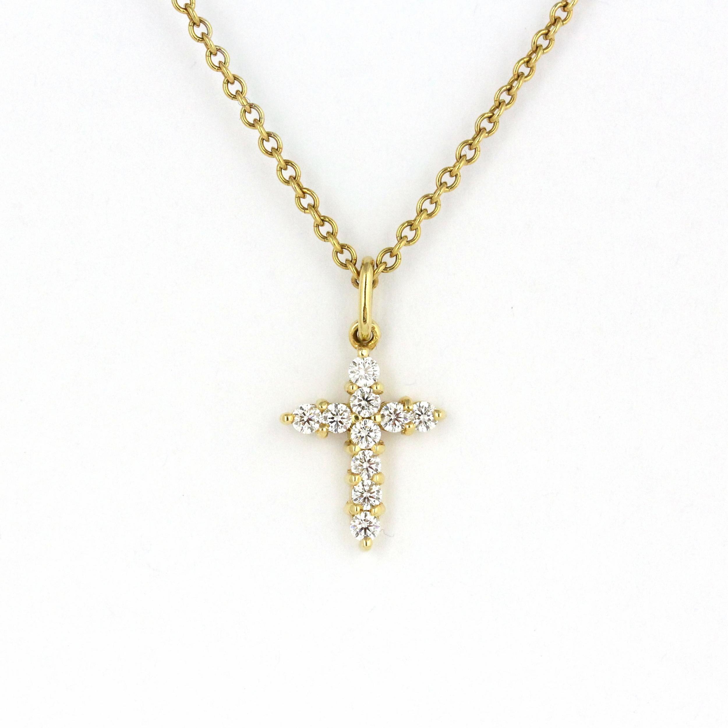 Yellow gold cross pendant set with diamonds.