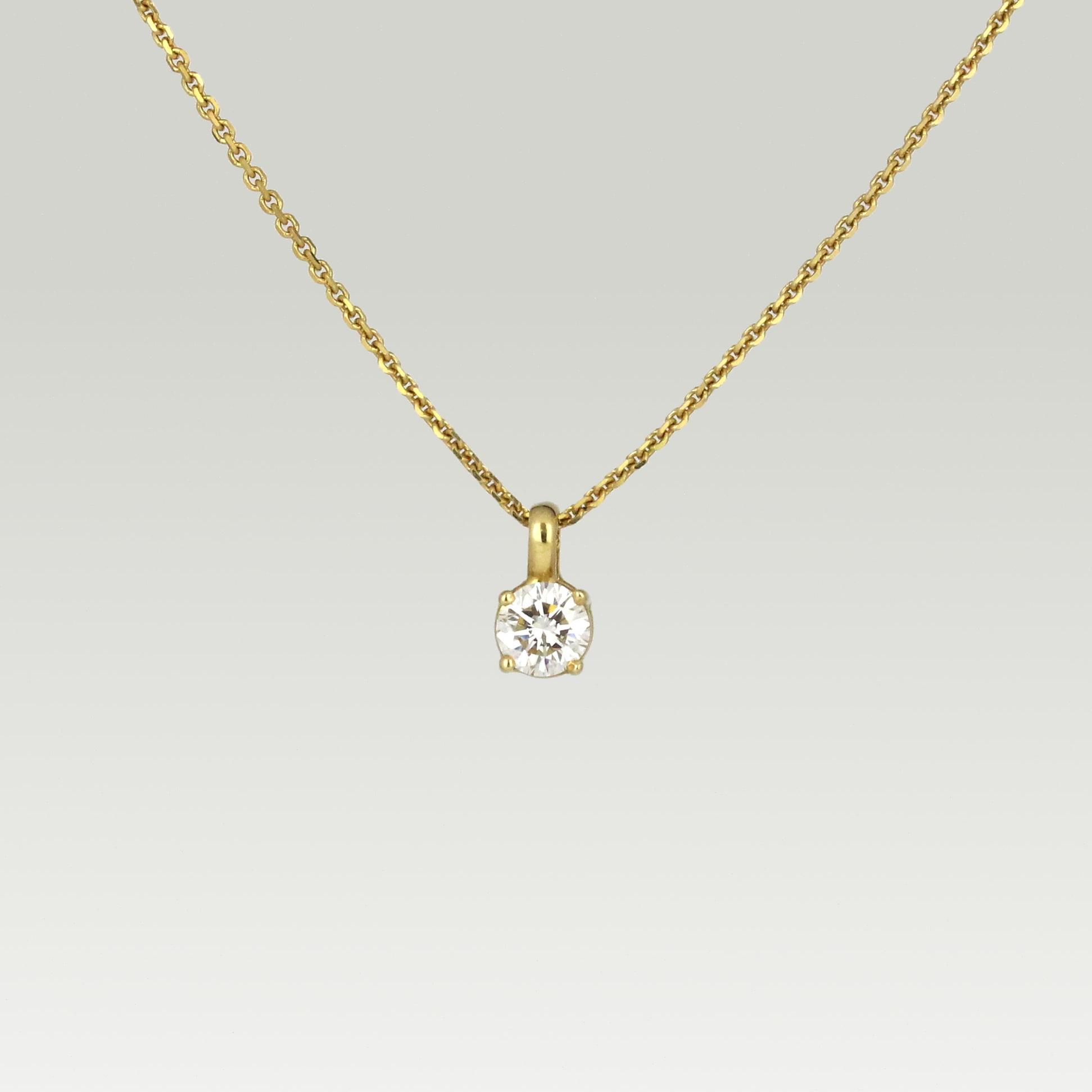 Yellow gold pendant set with diamond.
