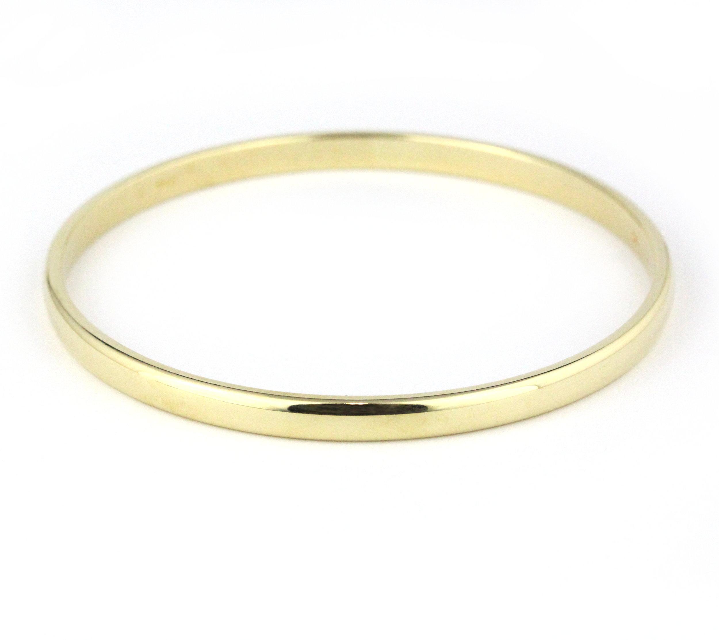 Thick yellow gold half round bangle.