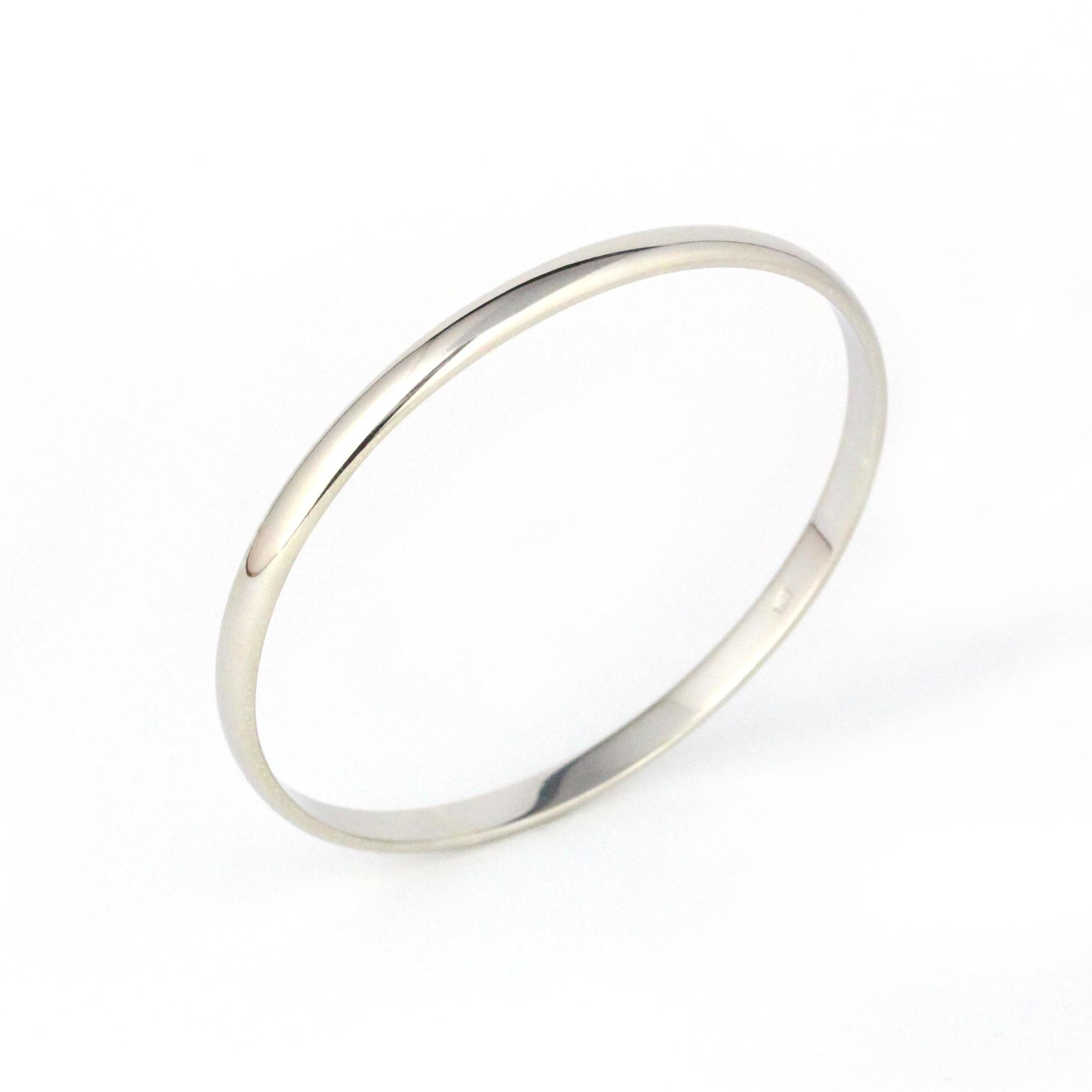 Thick white gold half round bangle.