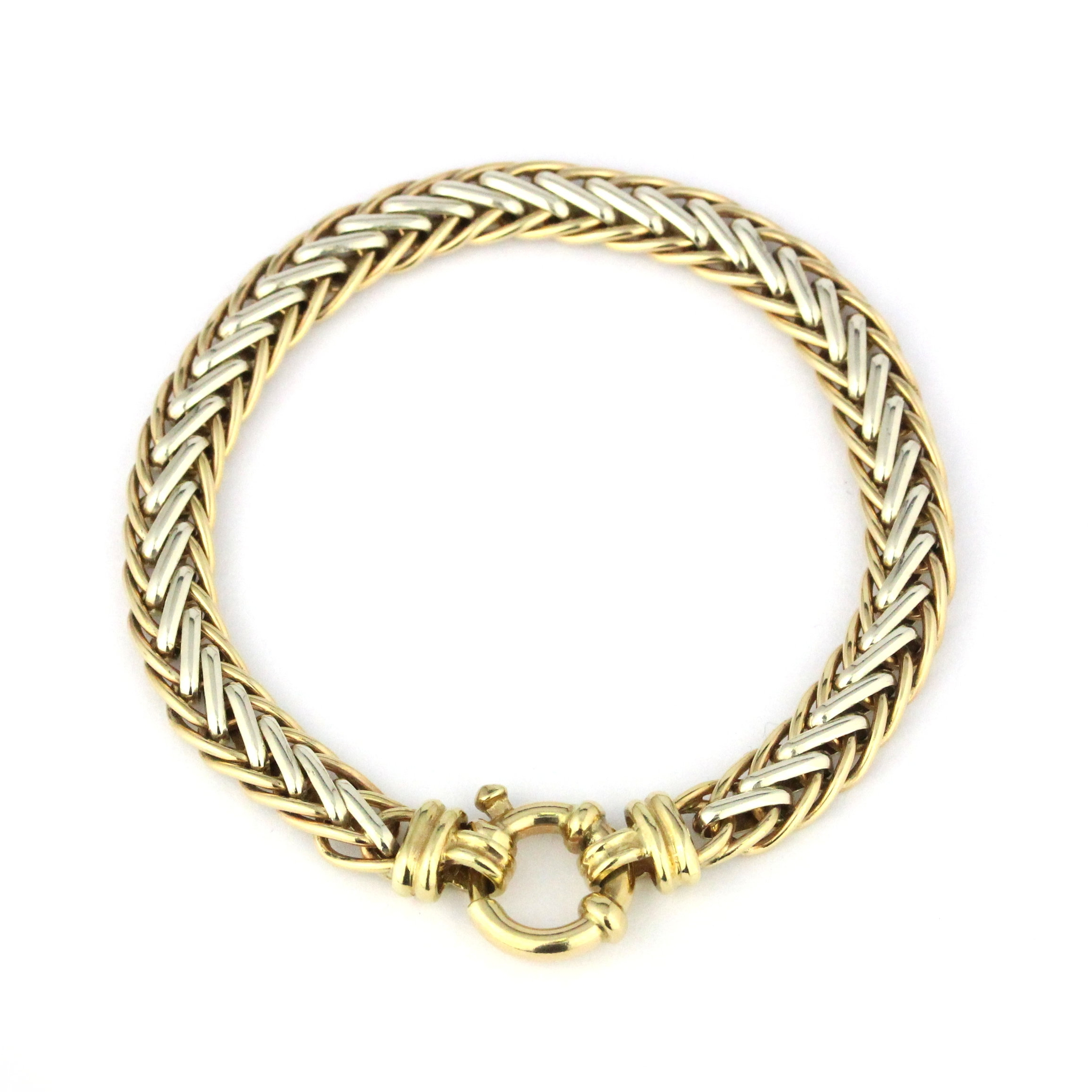 Yellow and white gold fishbone bracelet with bolt ring.