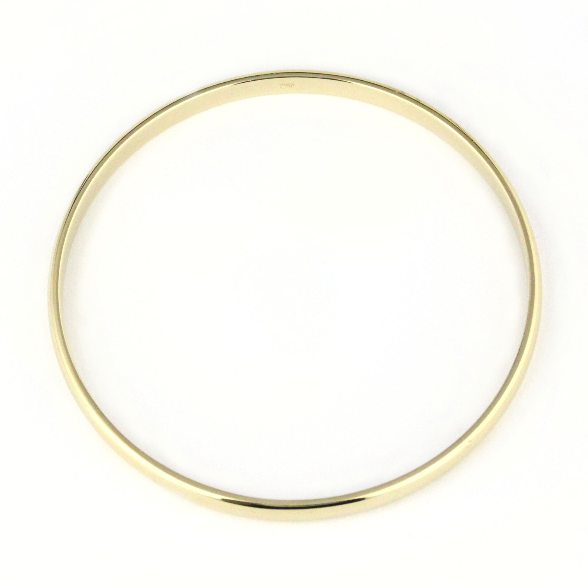 Thin yellow gold half round bangle.