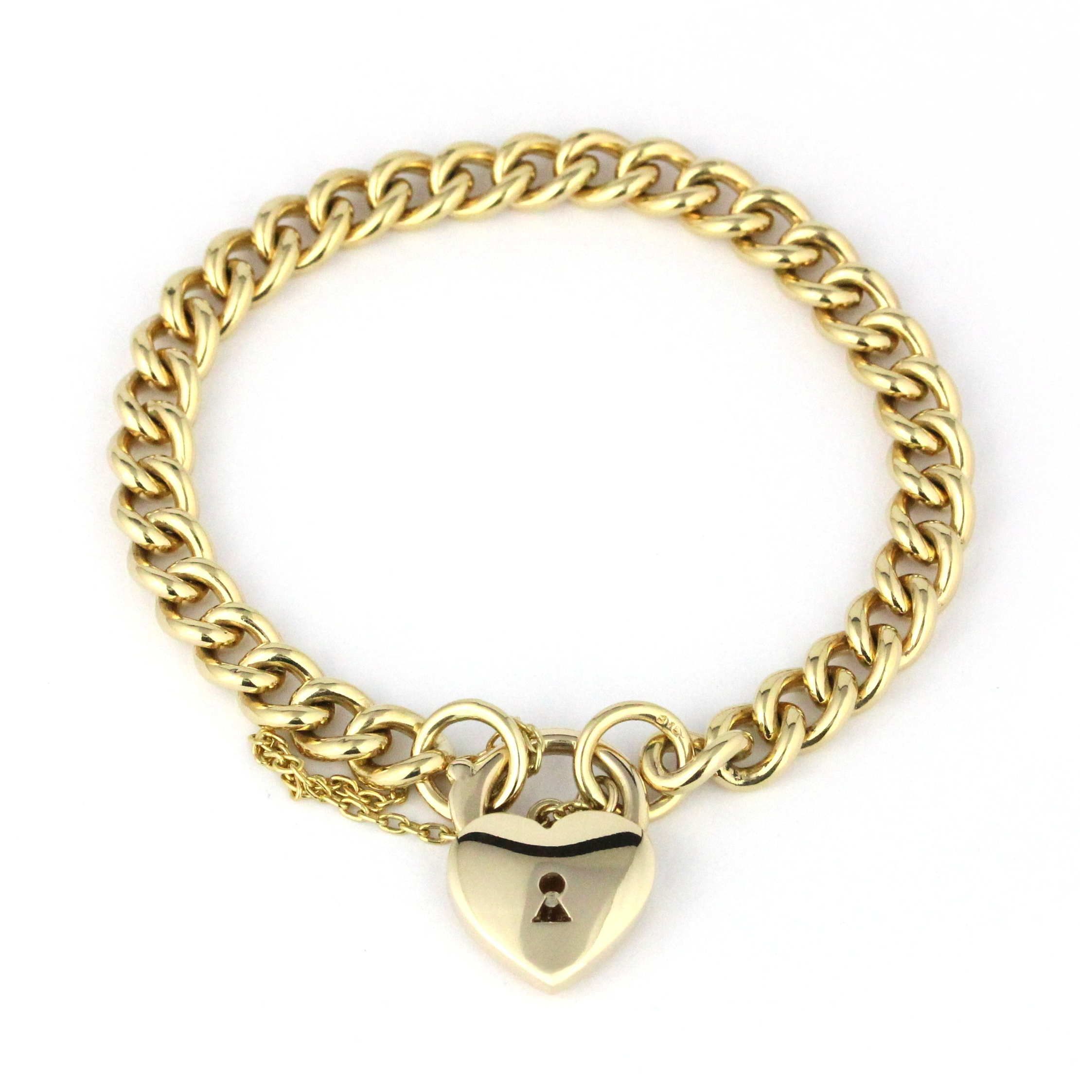 Yellow gold curb link bracelet with heart padlock clasp.