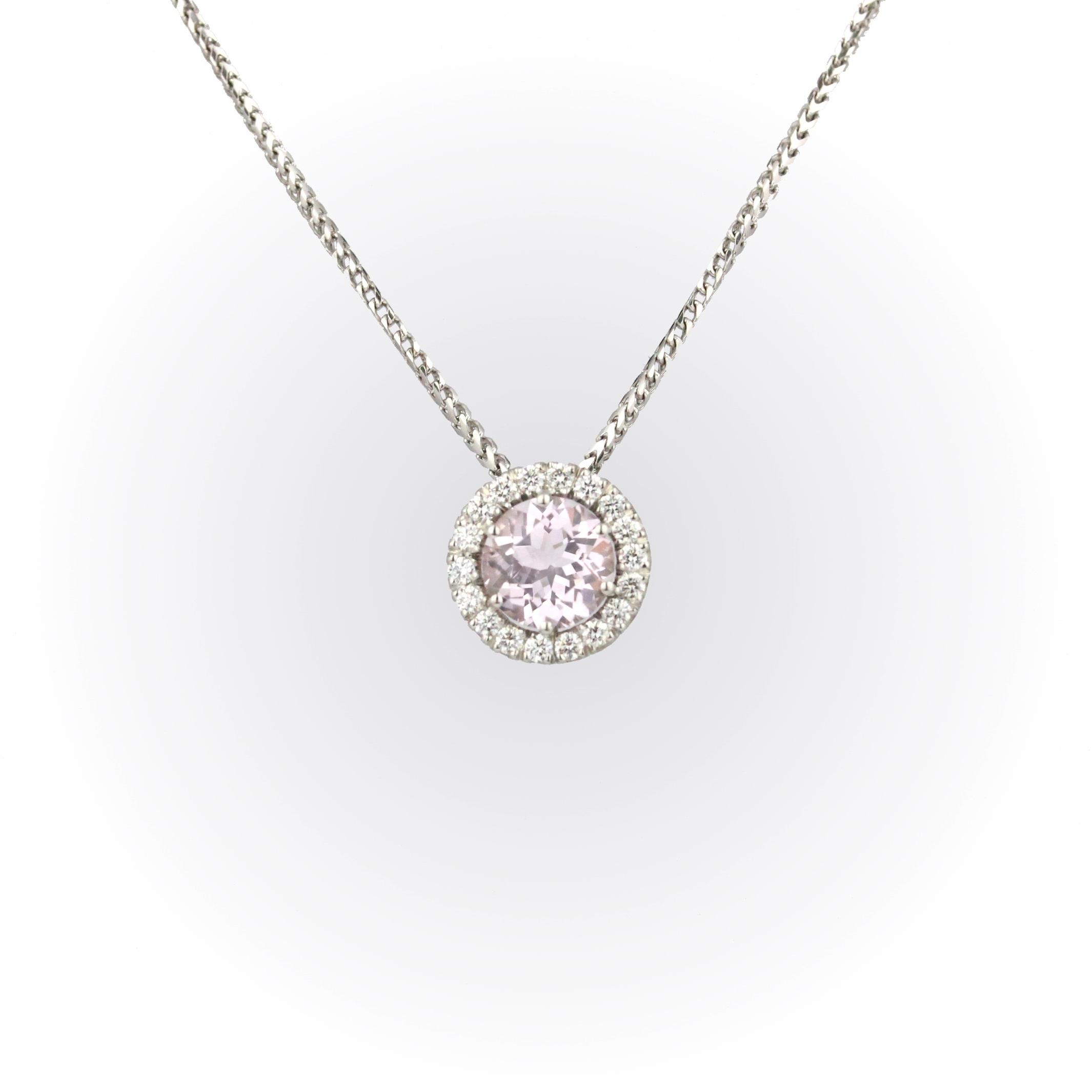 Round morganite with diamond halo pendant set in whtie gold.