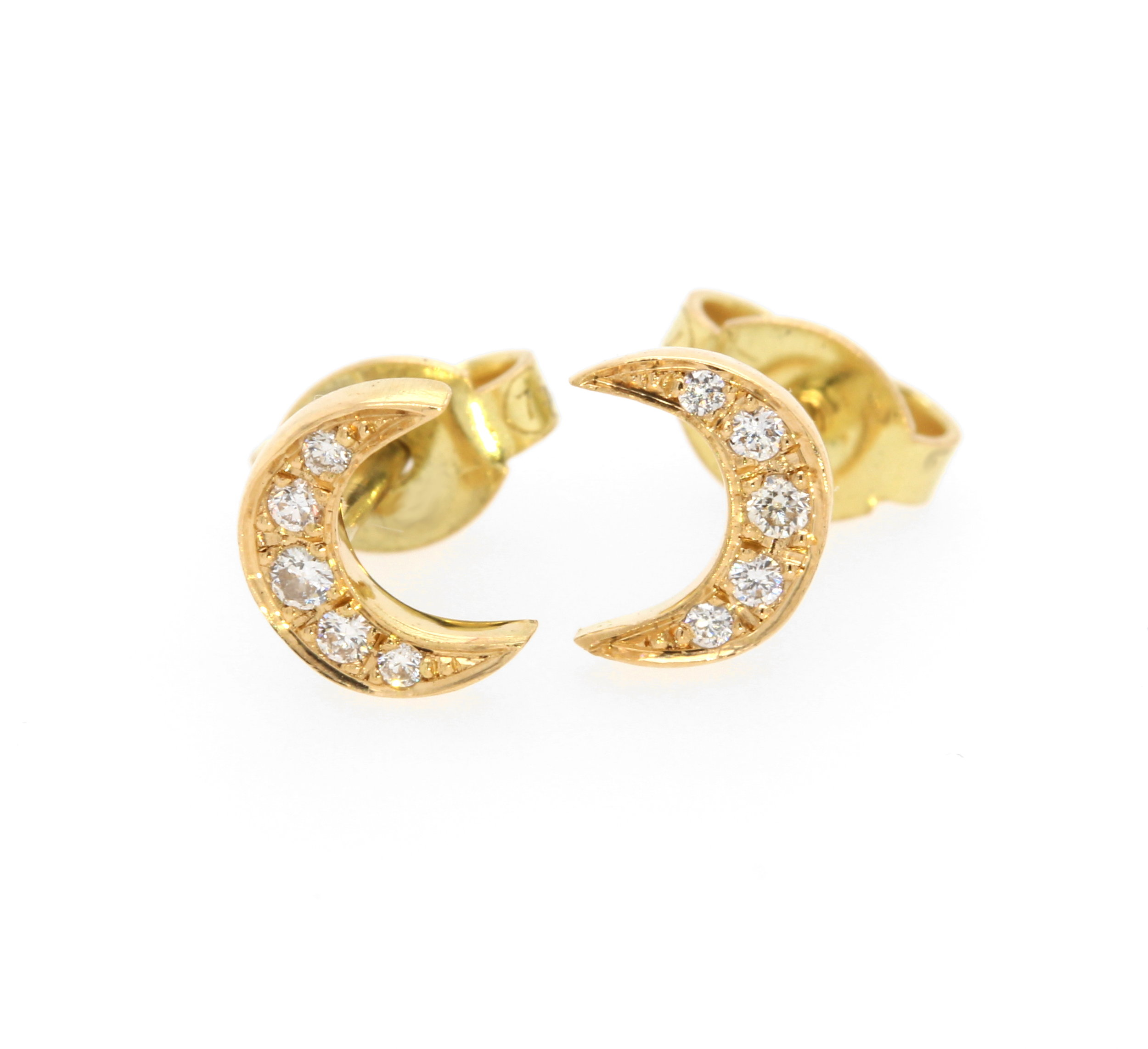 Diamond-set crescent studs in 18 karat yellow gold