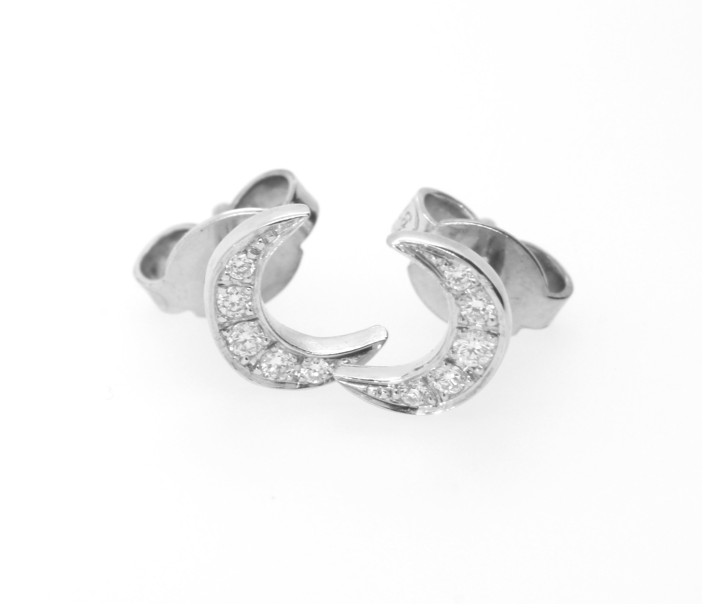 Diamond-set crescent studs in 9 karat white gold