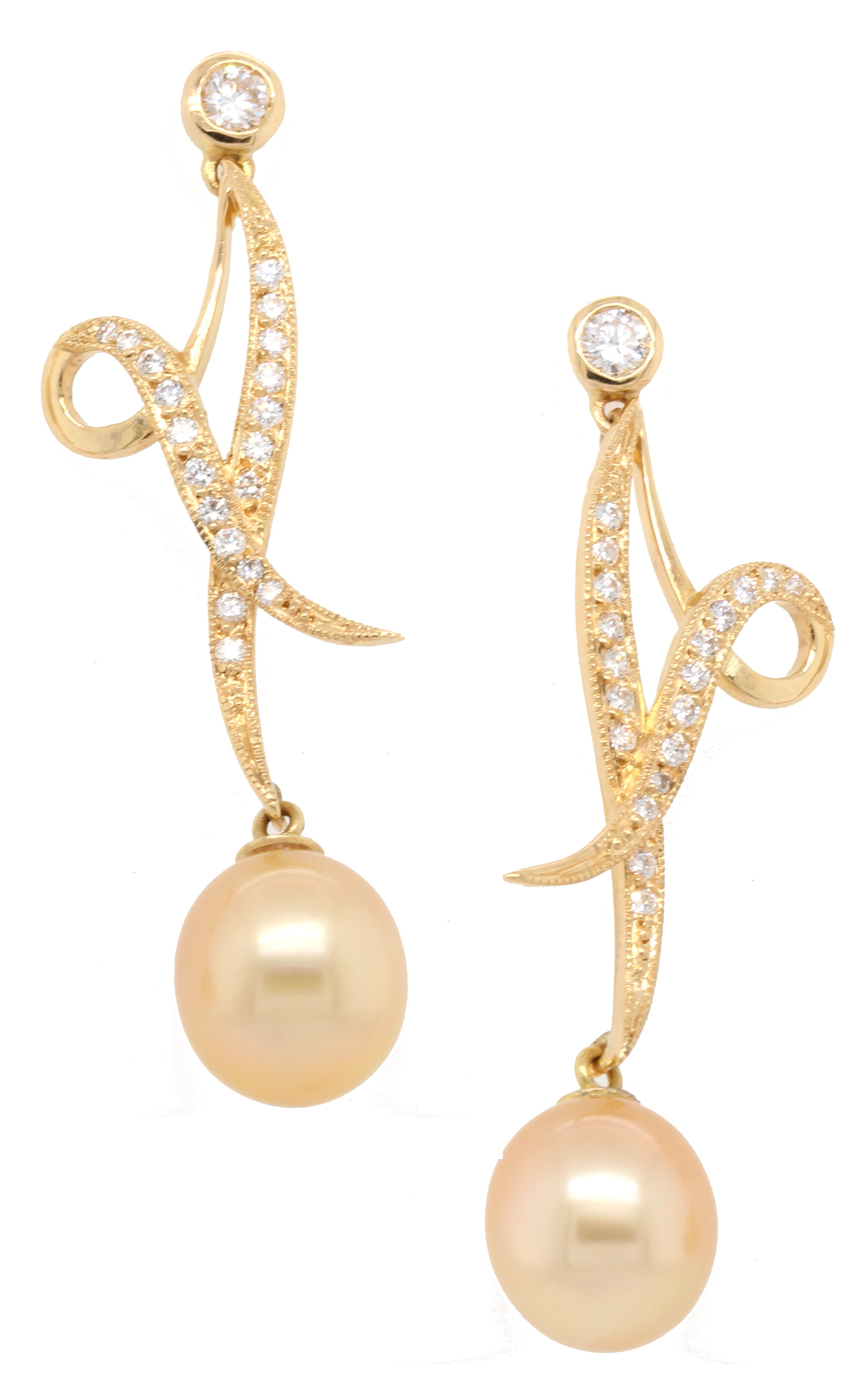 Diamond-set ribbon drop earrings supporting golden South Sea pearls