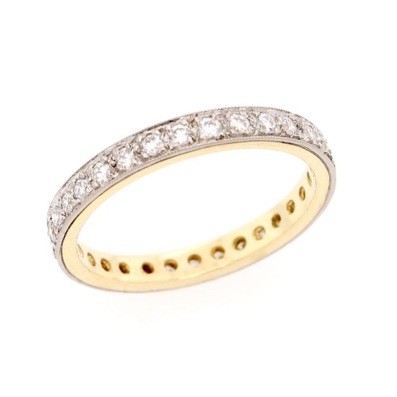 Grain-set eternity ring in 18 karat yellow gold