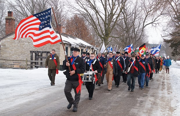 The Nauvoo Legion leads the walk down Main and Parley Streets in Nauvoo to commemorate the 1846 Nauvoo Exodus. Photo courtesy of Bruce Cornwell.