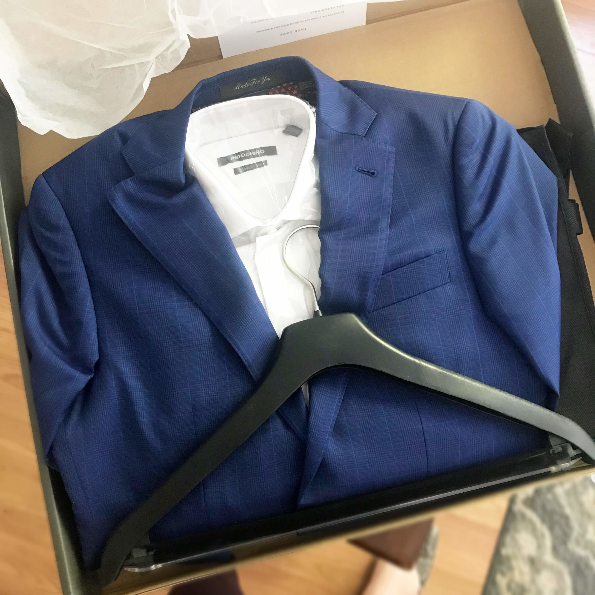 Your new suit comes with a very nice hanger and a garment bag.