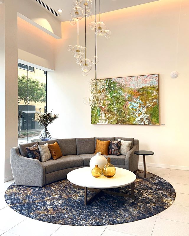 Styled // texture, fabric, foliage and those vibrant amber hues now complement our art procurement, the existing furniture and rug inset creating a soft and inviting feel to this commercial foyer space @aveonewstead. Brief met!  Call Amy on 0421129951 or email amy@designbybrutus.com.au .. .. .. .. .. @designbybrutus @derlindesign @richard.dunlop @janmurphygallery  #interiordesign #interiordesigner #styling #artistsoninstagram #artprocurement #seniorsliving #designlife #artwork #brisbanedesigner #brisbaneinteriordesigner