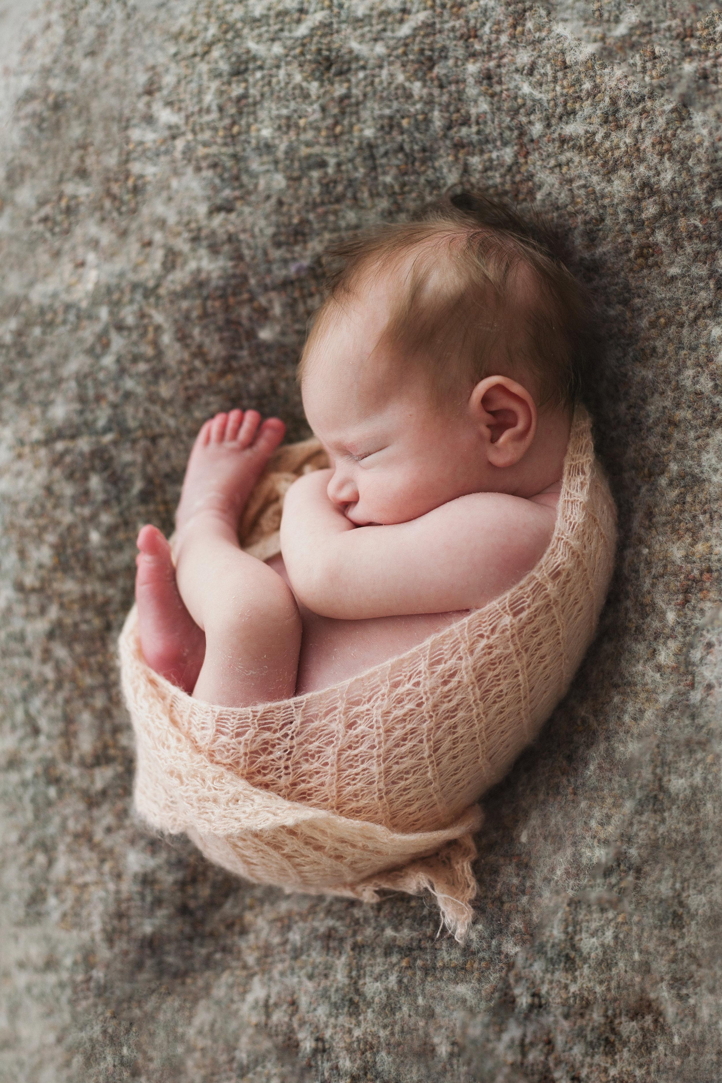 Ashley Logan Newborn Photography Wrapped Baby