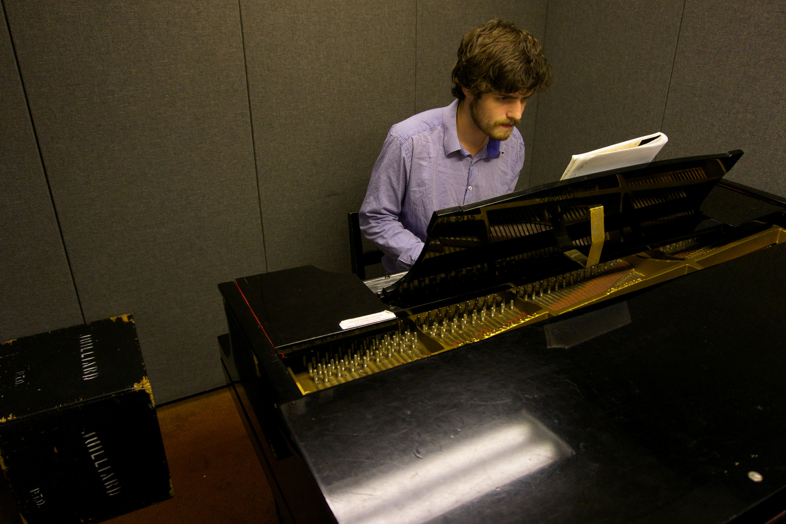 """All of the sudden, he jumps up, runs out of his room into one of the practice rooms and starts translating the notes from his paper to the piano keys. """"I think I found a solution,"""" he says. He is focussed on his music, completely in a different world. Every now and then he'll mumble something like """"I almost have it"""" or """"Shit this doesn't work"""" until he he says """"Oooh now I get it, it's actually a very simple solution, I just tried to make it more complicated than it is."""""""