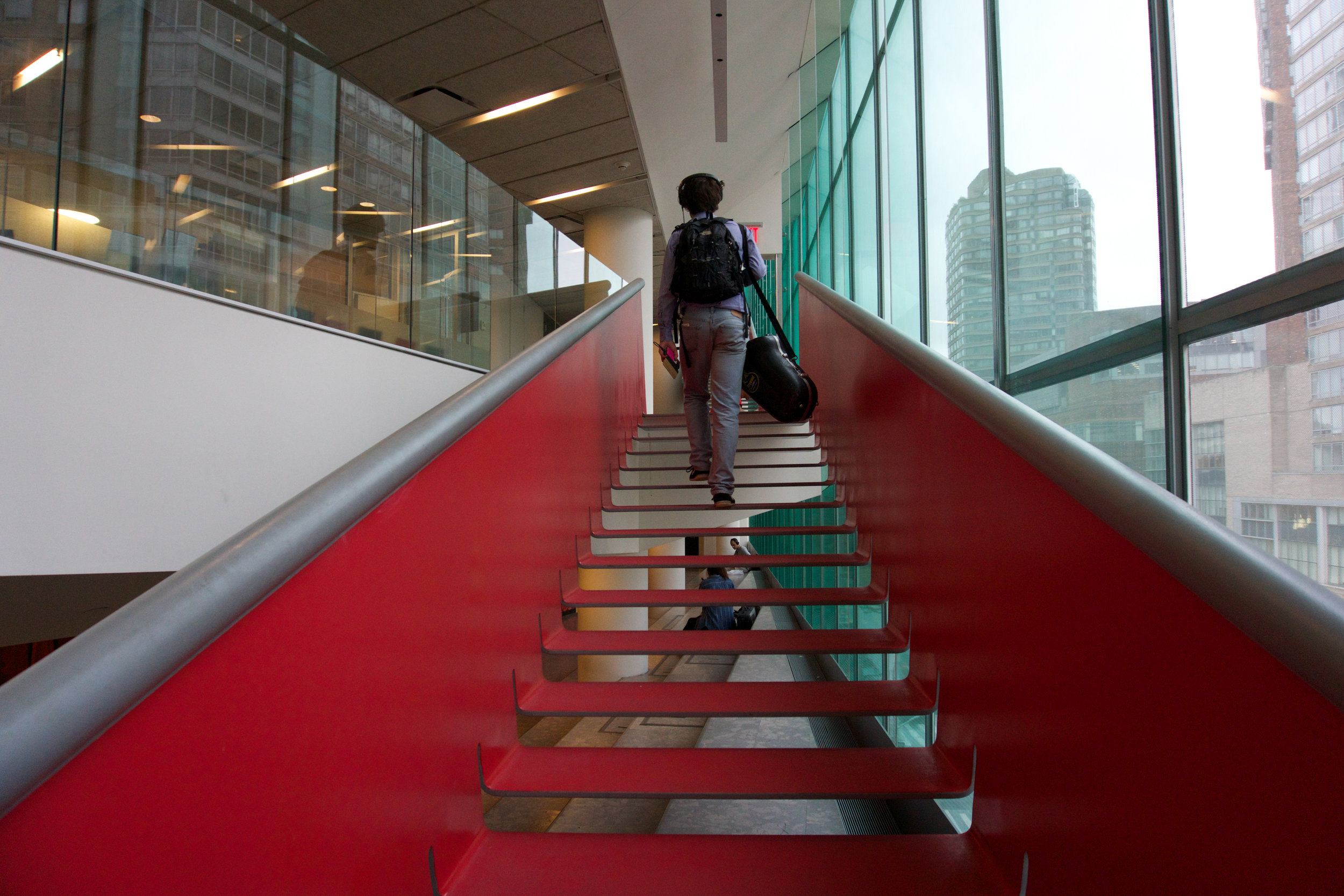 """02:30 PM - The second class of the day is about to start: Big band practice. """"It is funny how in this building most of it looks like any other university building: grey and boring. And then there are these few parts where all of the money goes to, like these red stairs."""""""