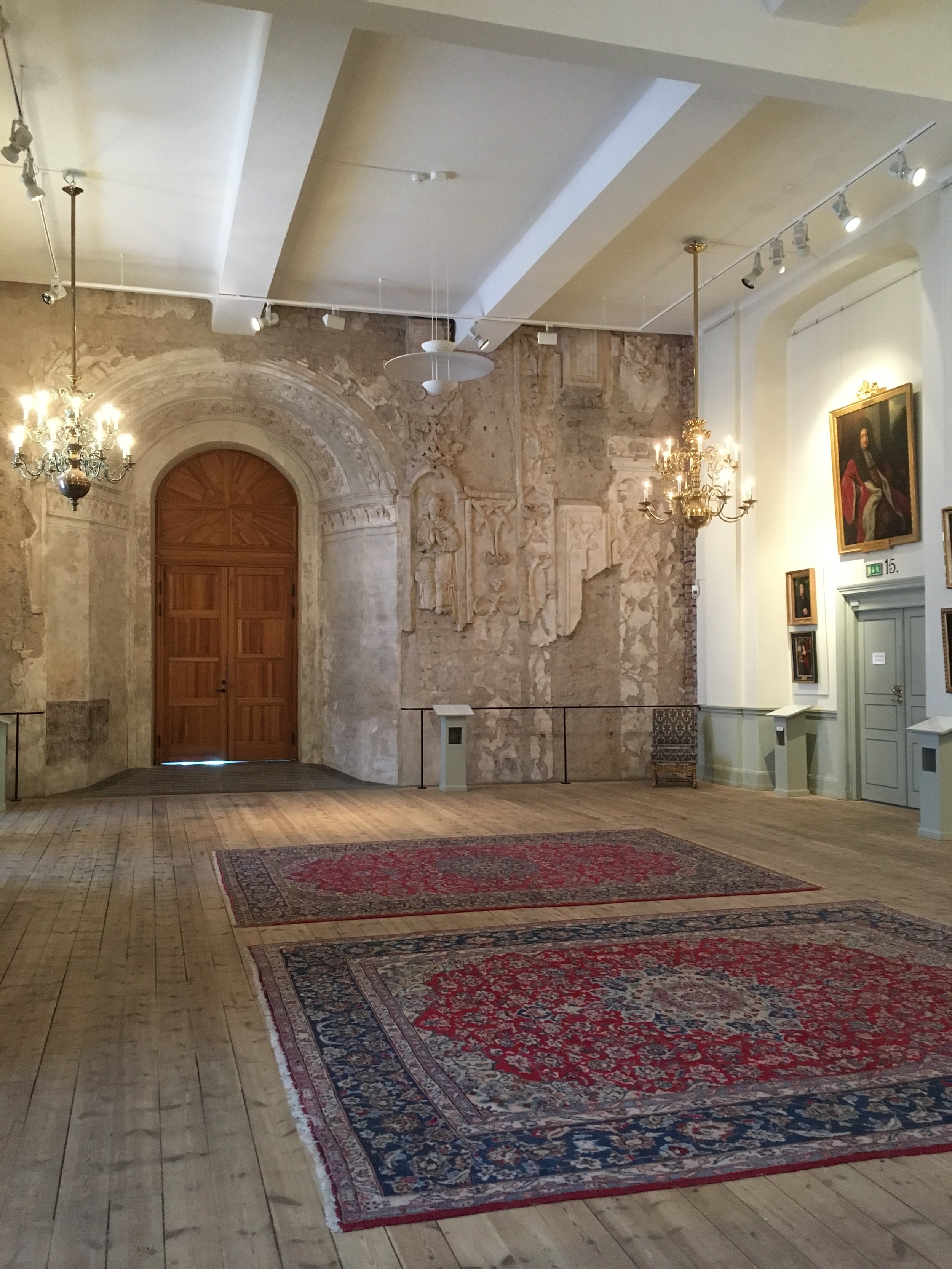 The decorative carvings are what remains of the old Castle Chapel that used to be in this wing. Over the years the Chapel was repurposed and extra floors and walls were built into the space. Country Governor's festive venues are on the other side of the wall.