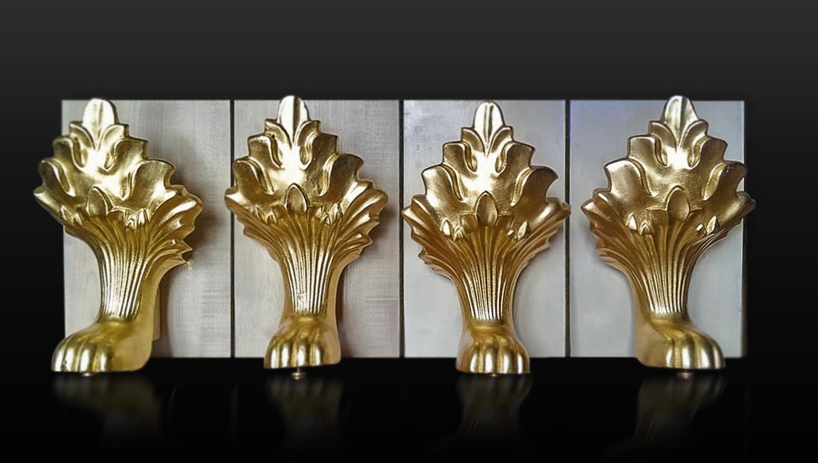 7.24 karatų aukso lapeliais dengtas metalo paviršius.