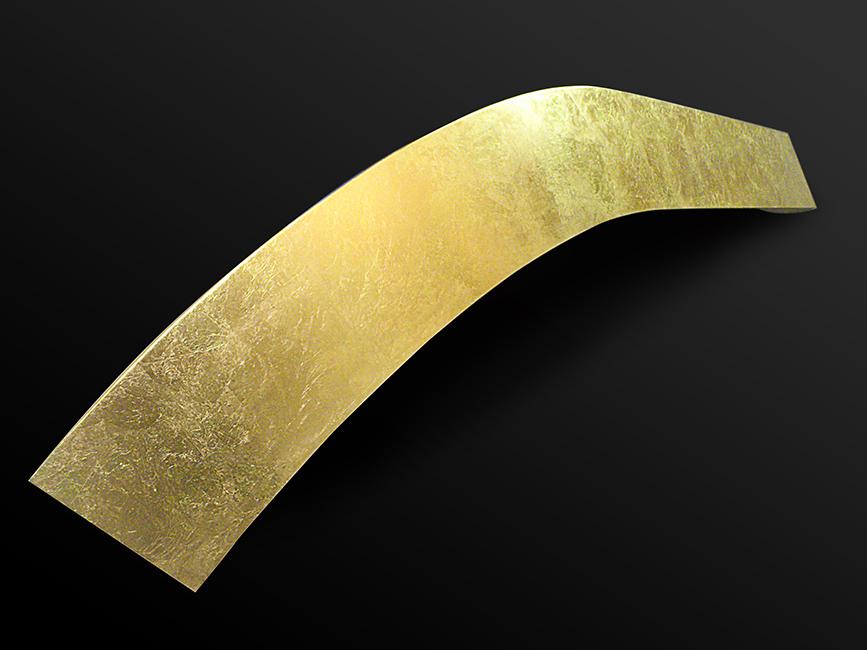 23. Aukso lapeliais padengtas metalo paviršius.