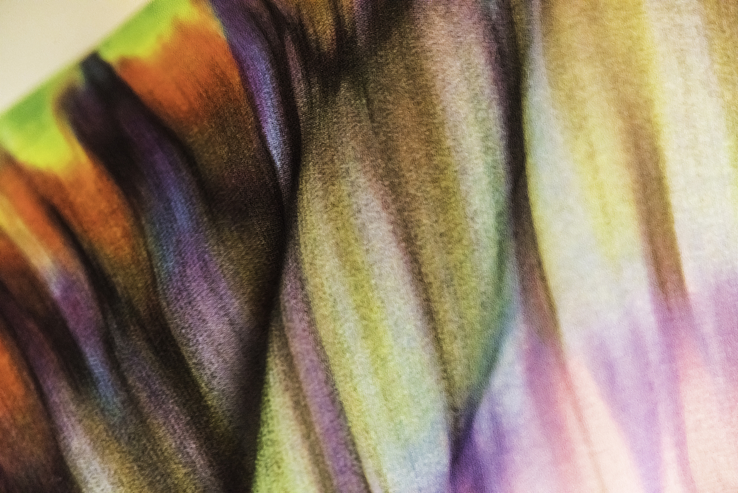 A small section of colorful fabric shot at 1200 mm focal length