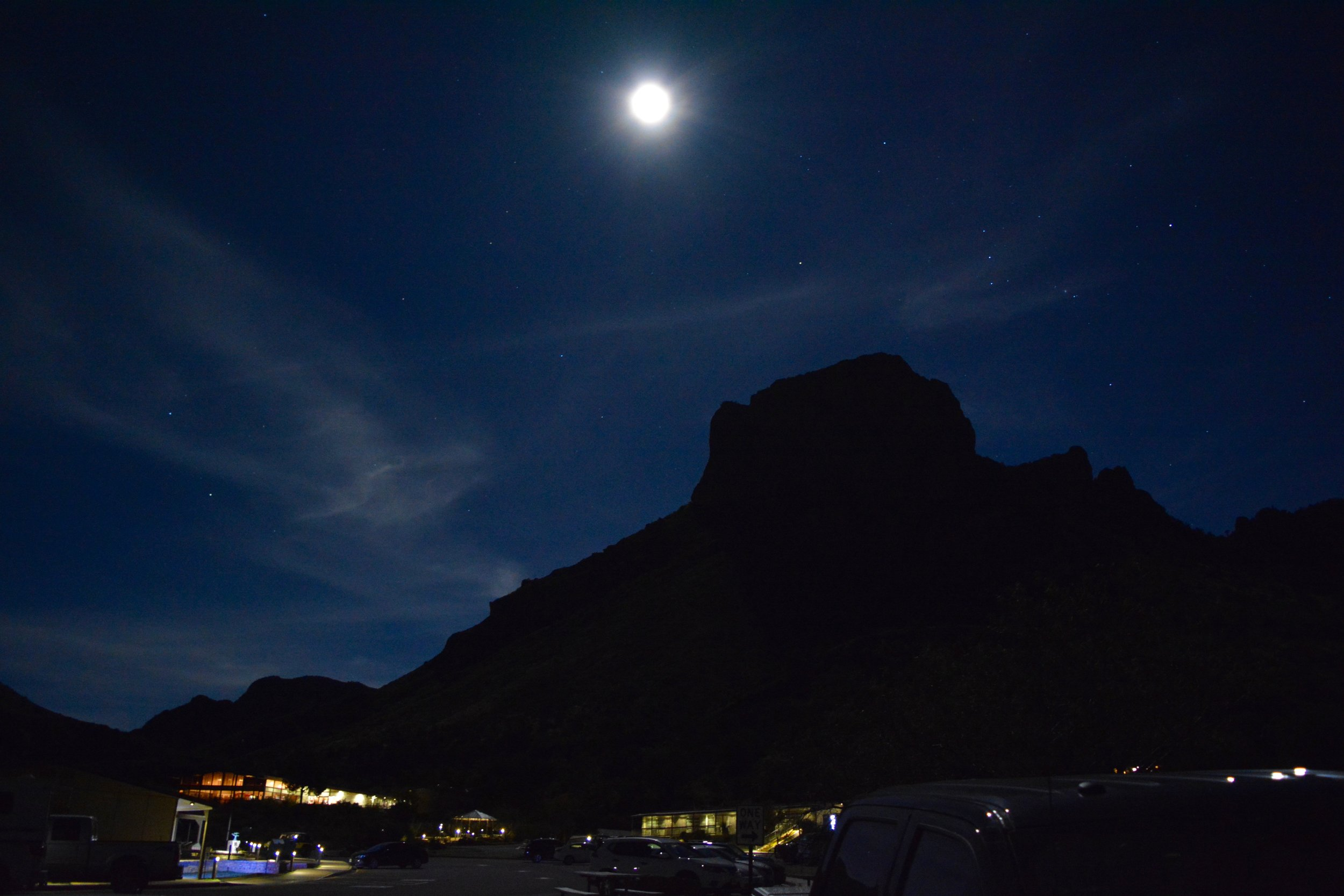 The full moon and night sky above the Chisos Mountain Lodge
