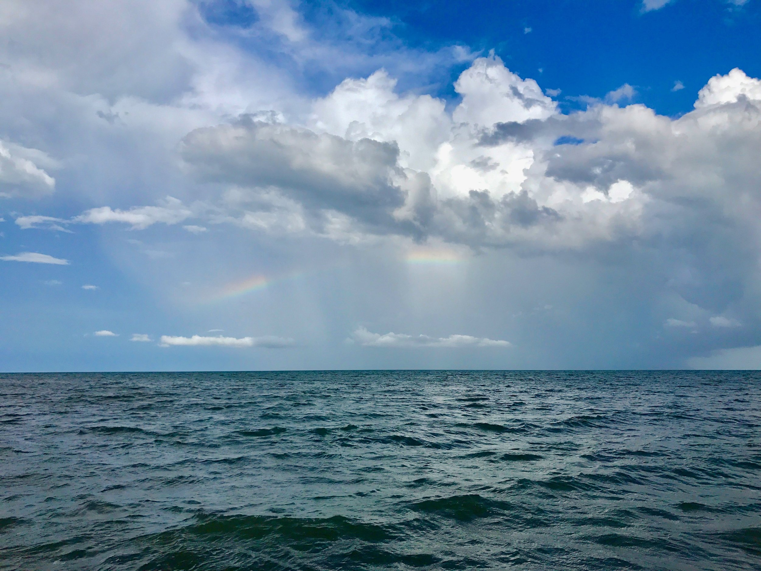 Lots of rain has its plusses - a rainbow over the Gulf of Honduras