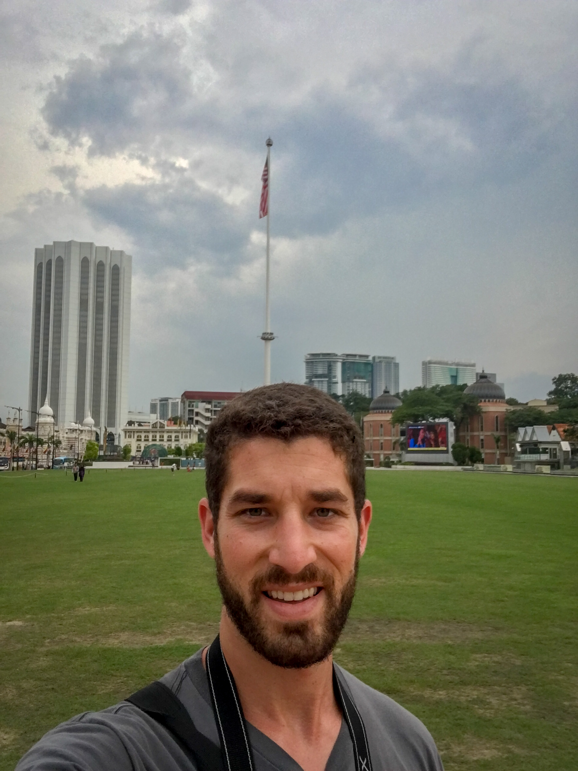 """Merdeka Square, or """"Independence Square"""", and the flagpole behind me where the Union Jack was lowered and Malaysian Flag was raised on midnight of August 30th / 31st, 1957. It is one of the tallest flagpoles in the world, standing at 312 feet."""