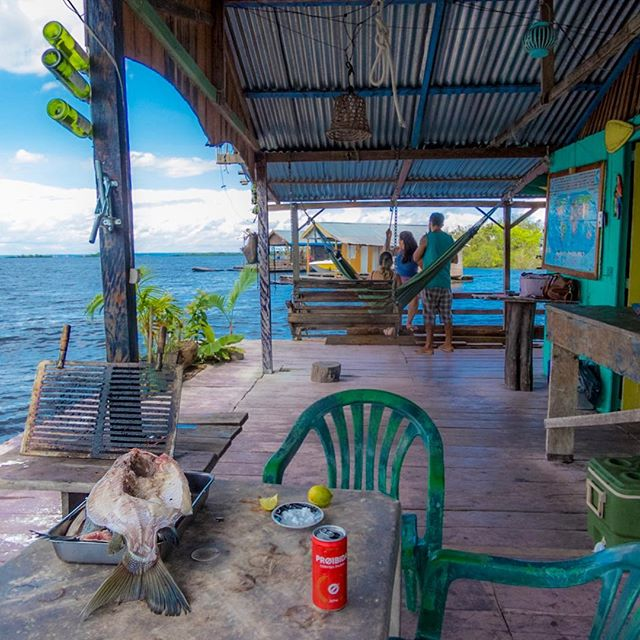 Scenes from a floating house on the Rio Negro, an arm of the Amazon River. There are ten floating houses in this village, and the river is the main road. In this pic, we are about to grill the large tambaqui, a fish from the region that is popular to eat. #savetheamazon
