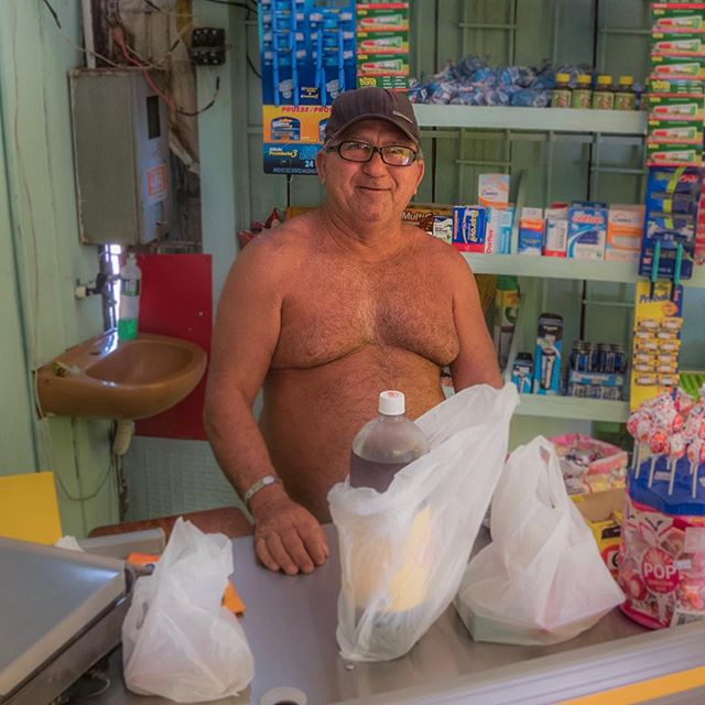 """""""Do you know where you are? You're in the lungs of the world"""" this grocer told me. . This grocery store is on the banks of the Rio Negro, an arm of the Amazon River. The river has a laid back culture, so much so that even this grocer was shirtless while at work 😎 #savetheamazon"""