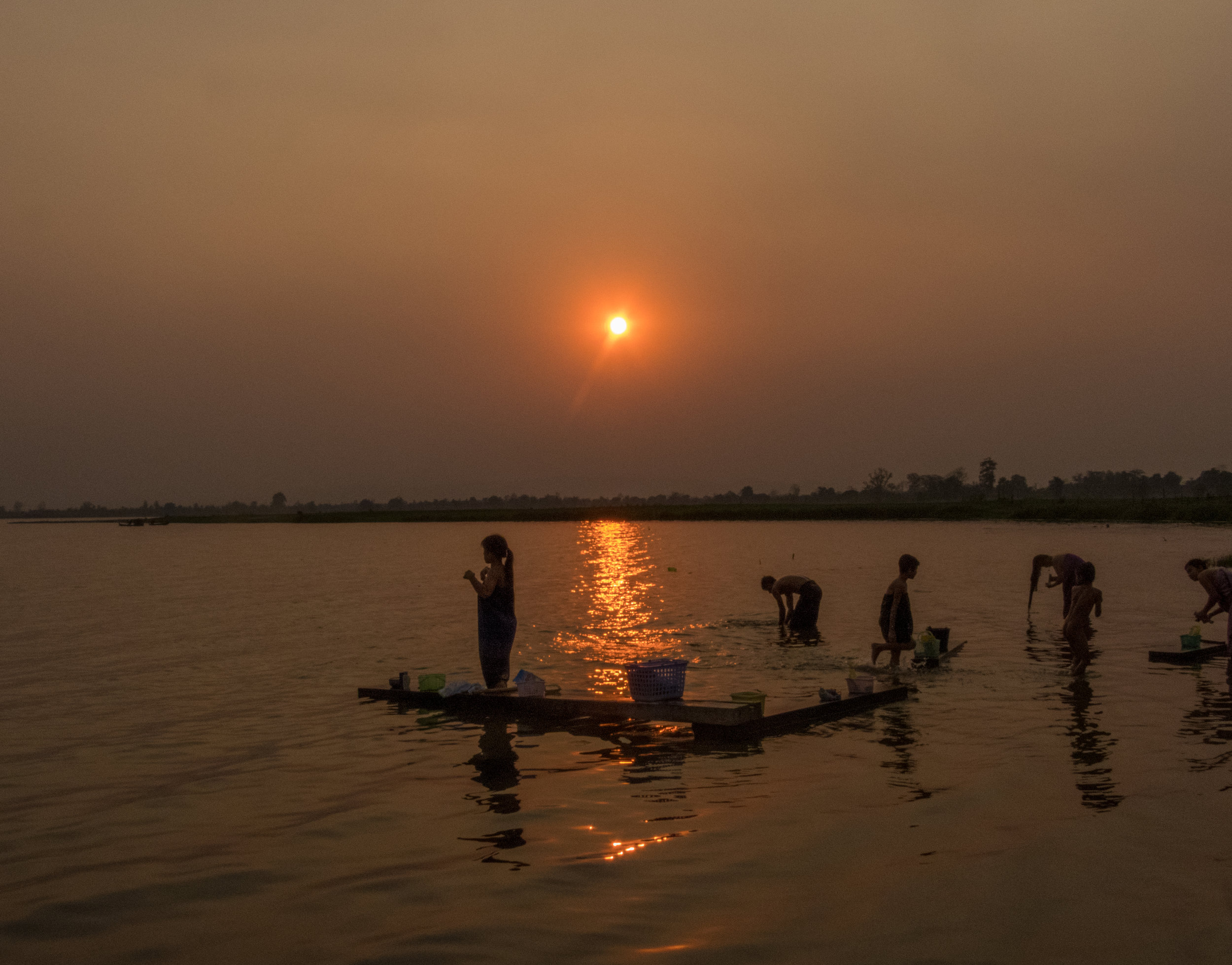 Families bathe and wash their clothes in Lake Indaw.