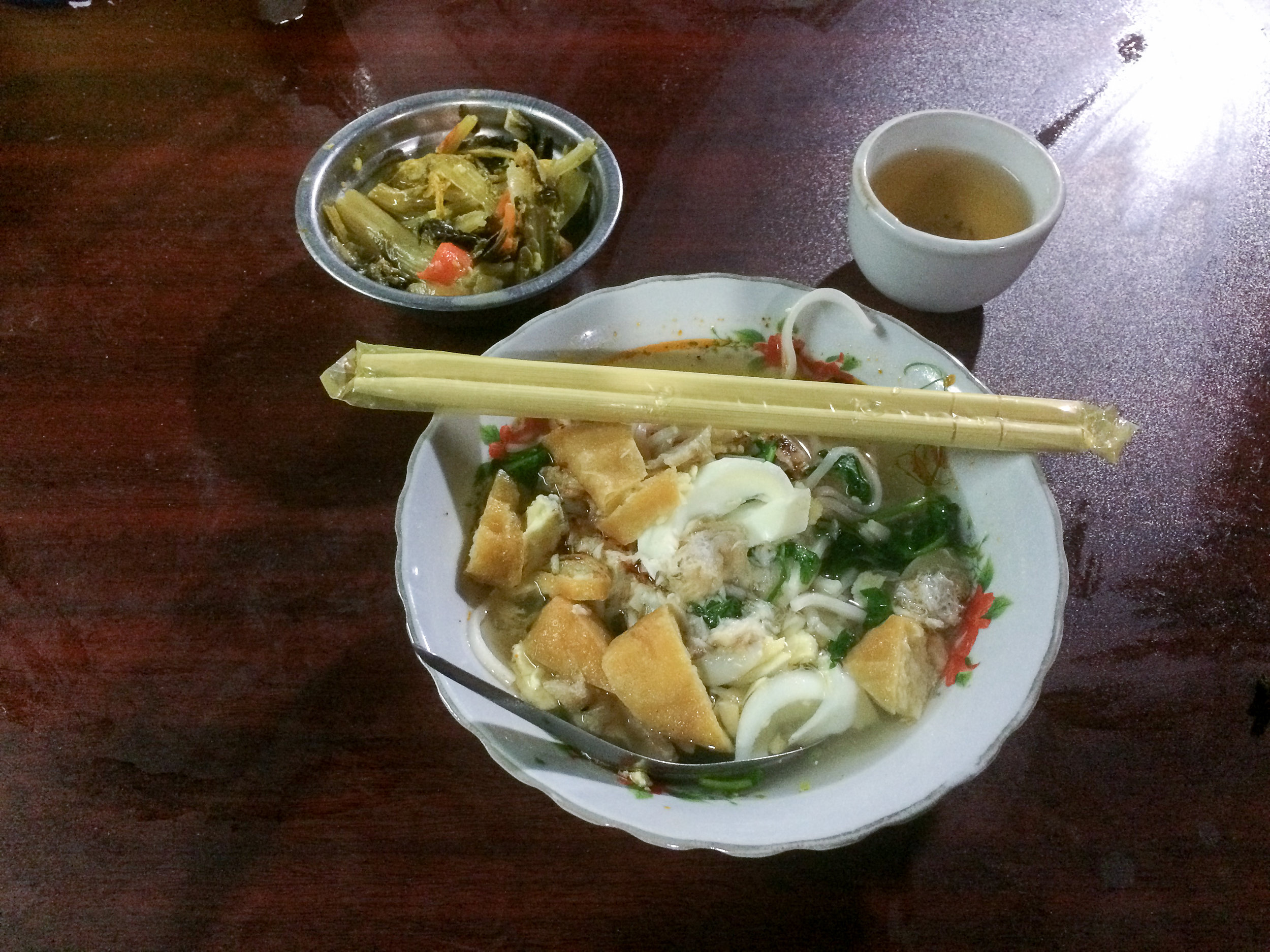 Delicious soup and tea! Note the small bowl of pickled vegetables - a side dish that is served with almost everything in Myanmar, even breakfast.