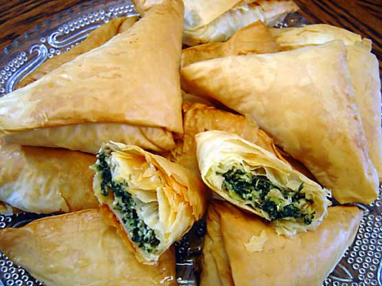 Spanakopita  a delicious pastry with a filling of chopped spinach, feta cheese, onions or scallions, egg, and seasoning.The filling is wrapped or layered in phyllo (filo) pastry with butter