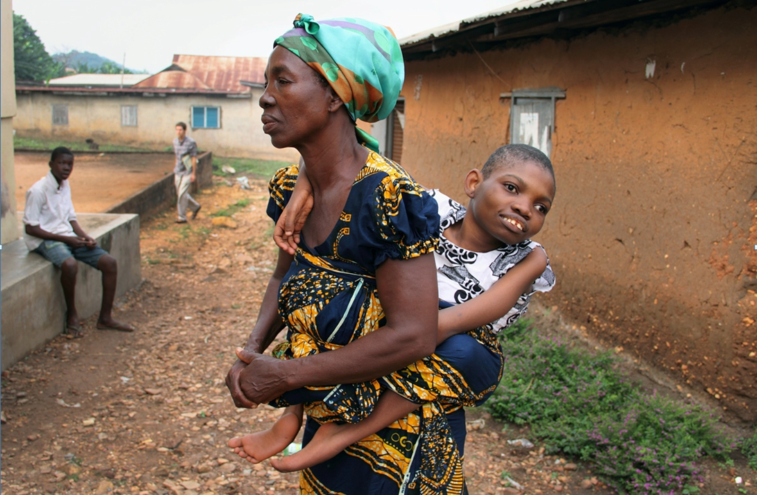 Mawunyo and her mother: This is the only way that Mawunyo's family could take her from one place to another before she received her wheelchair.