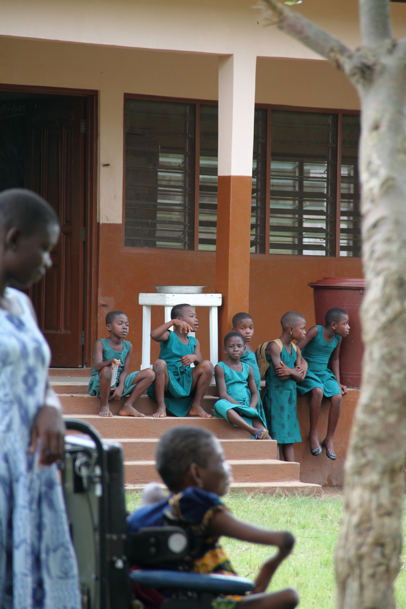 Mawunyo on break watching the other children at the school.