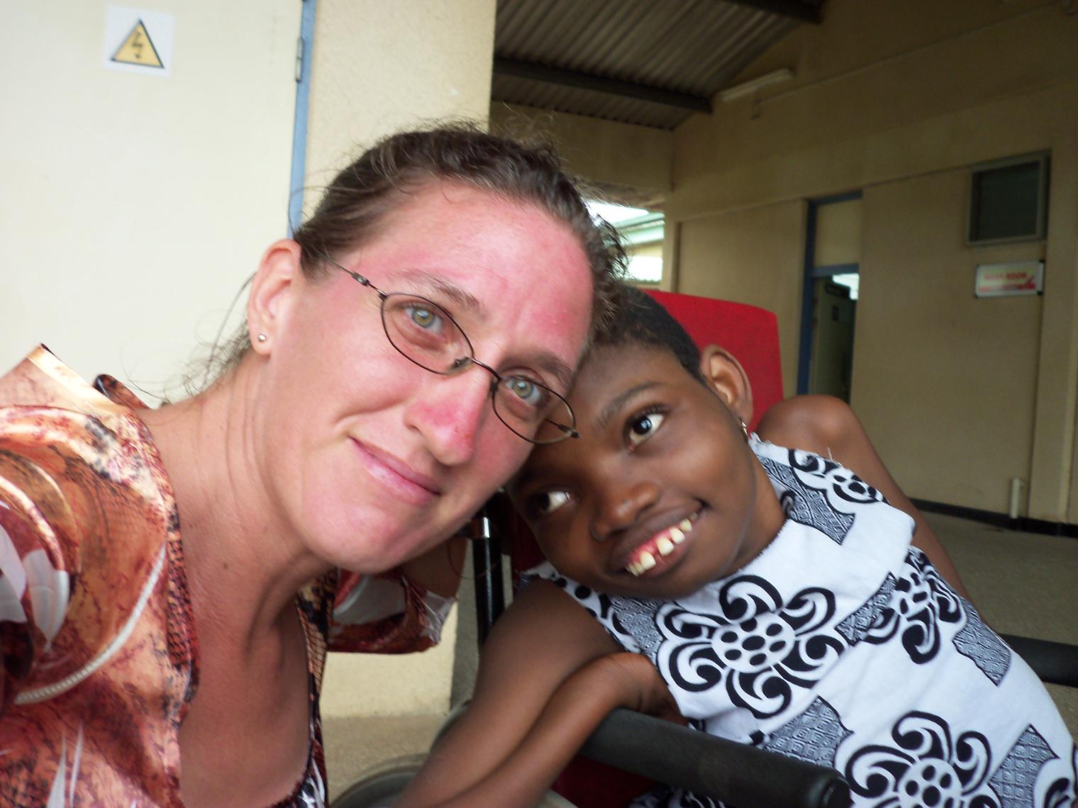 Carrie and Mawunyo in new wheelchair.jpg