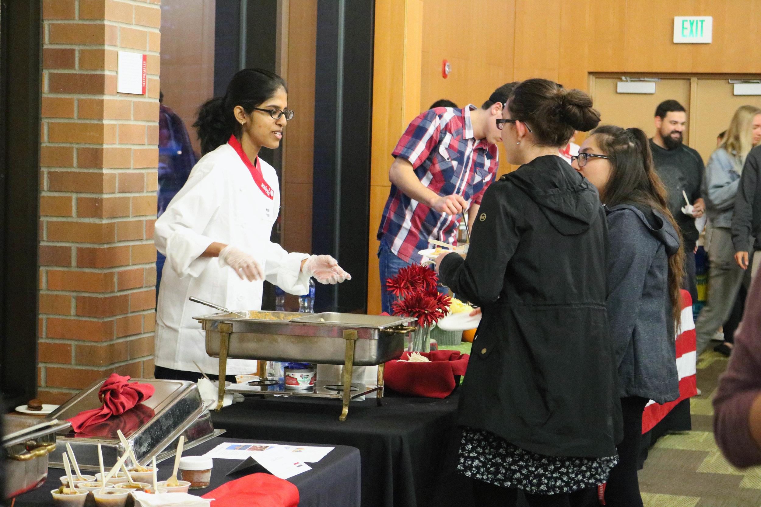 Senior Harika Echuri serving food during Top Chef, Nov. 12.