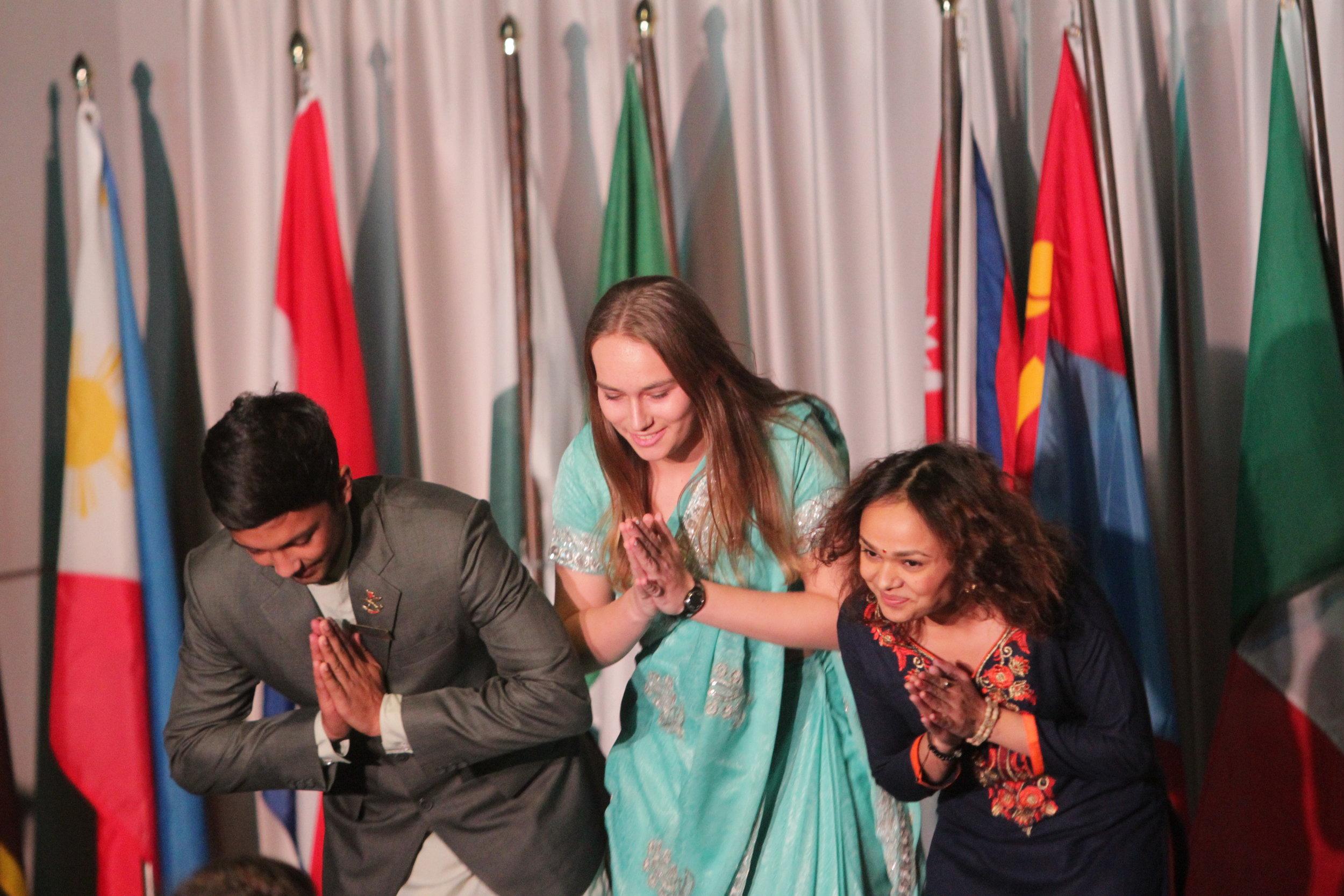 Sophomore Ishan Gauli, sophomore Michaela Scheer and senior Purnima Karki representing Nepal