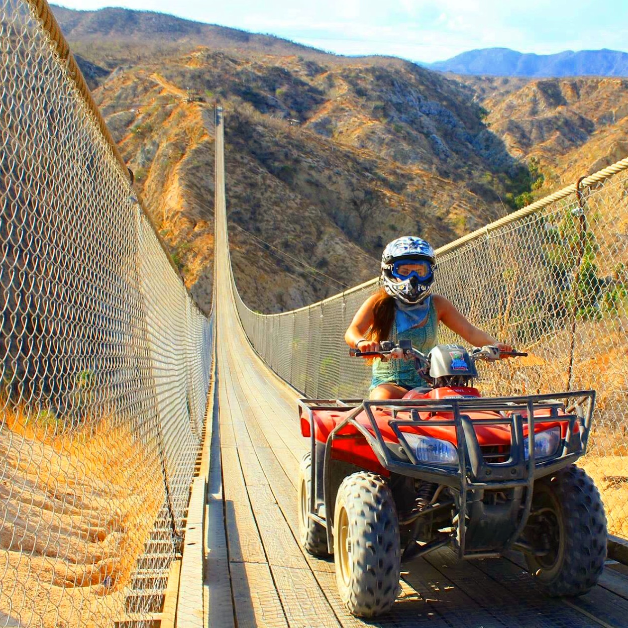 Jessica, ATV riding in Cabo along the longest suspension bridge.