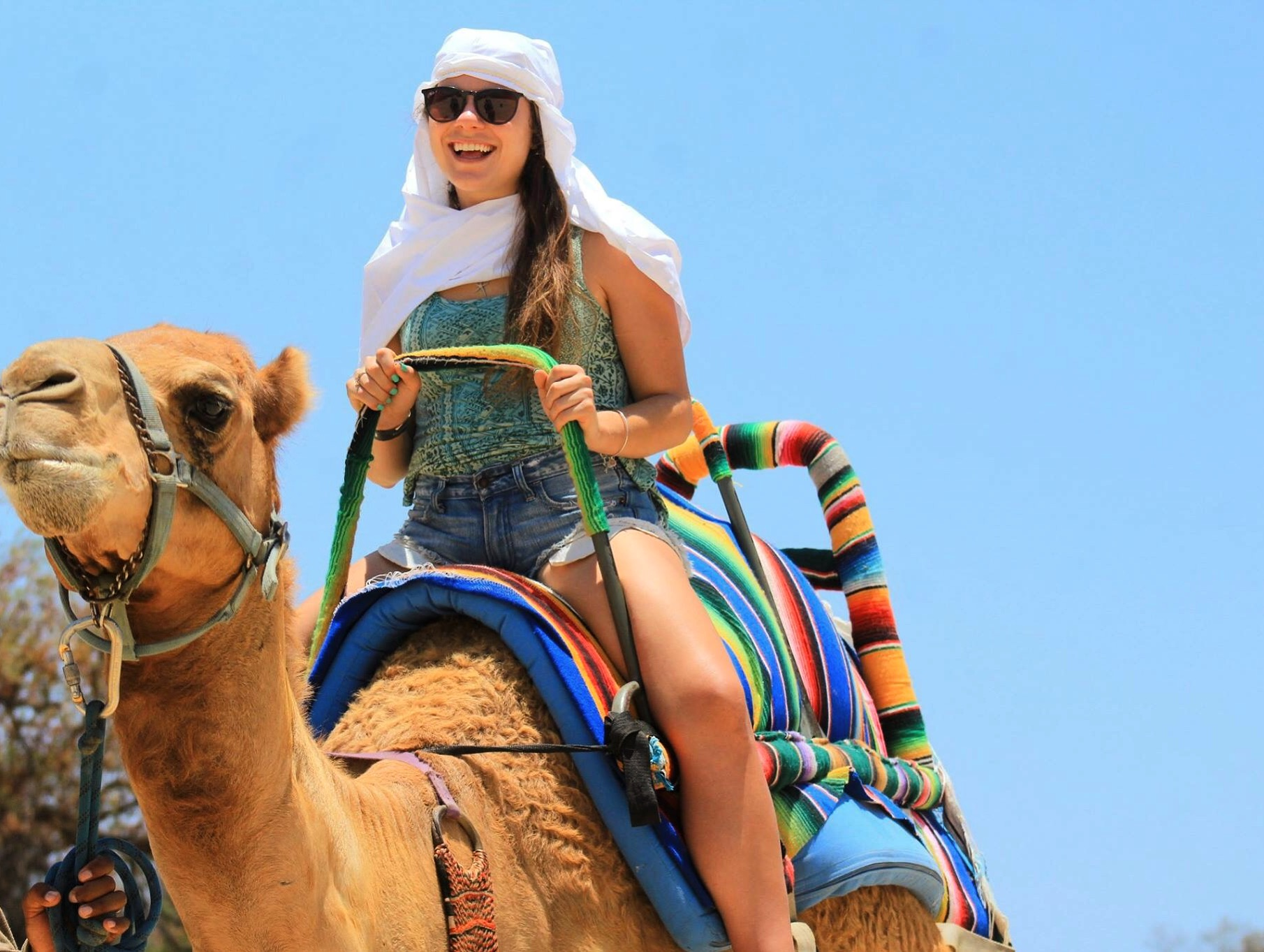 Jessica, camel riding in Cabo.