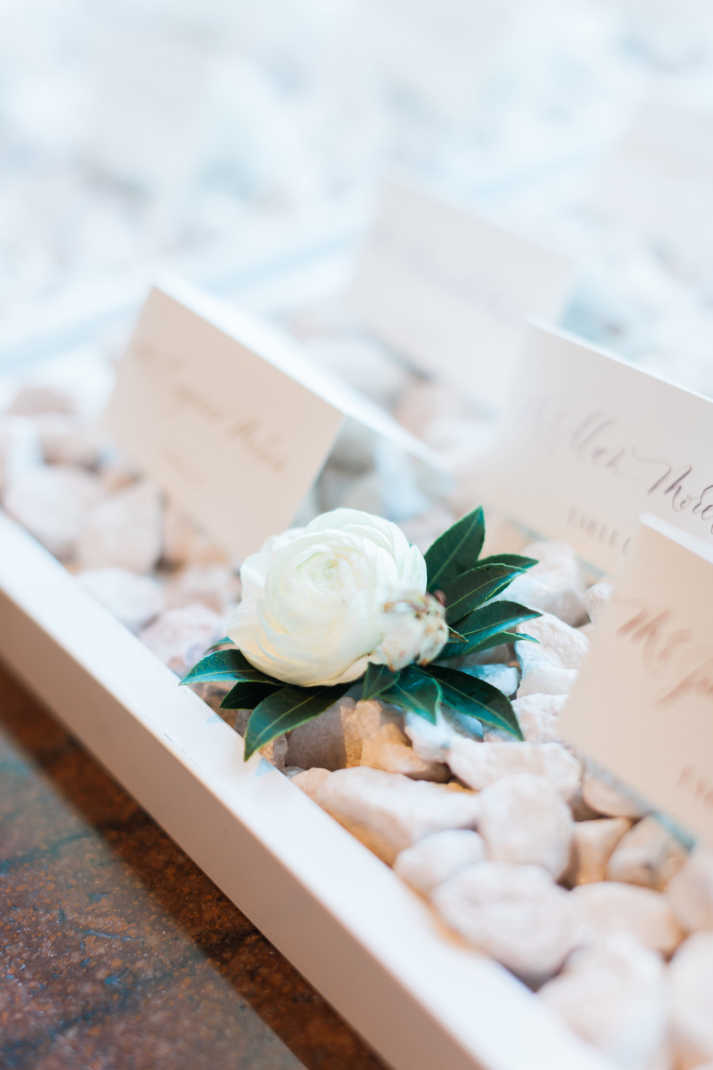 Escort card display for an all white wedding by Layers of Lovely