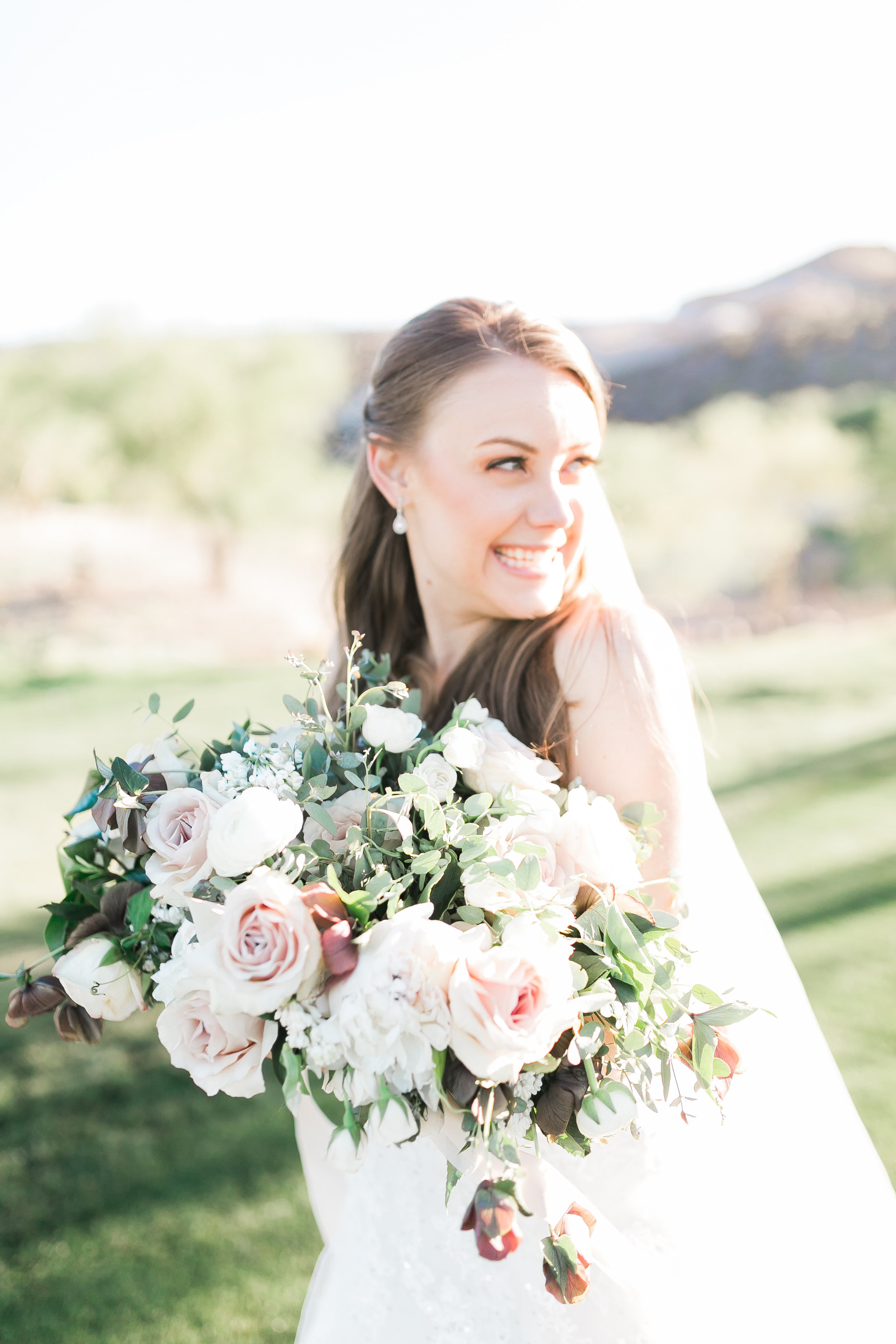 Spring bridal bouquet with blush and mauve blooms by Layers of Lovely