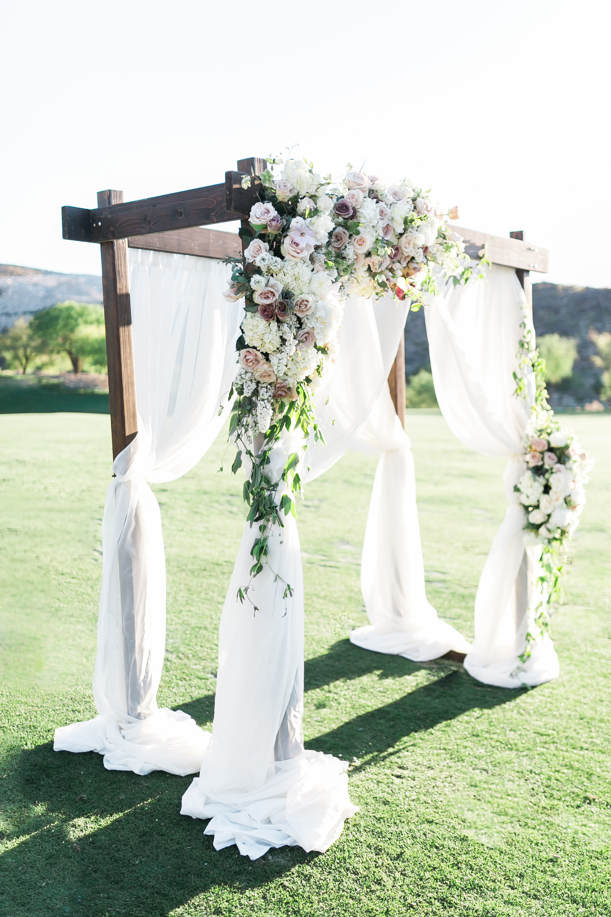 Garden arbor with blush and mauve blooms. Layers of Lovely Floral Design