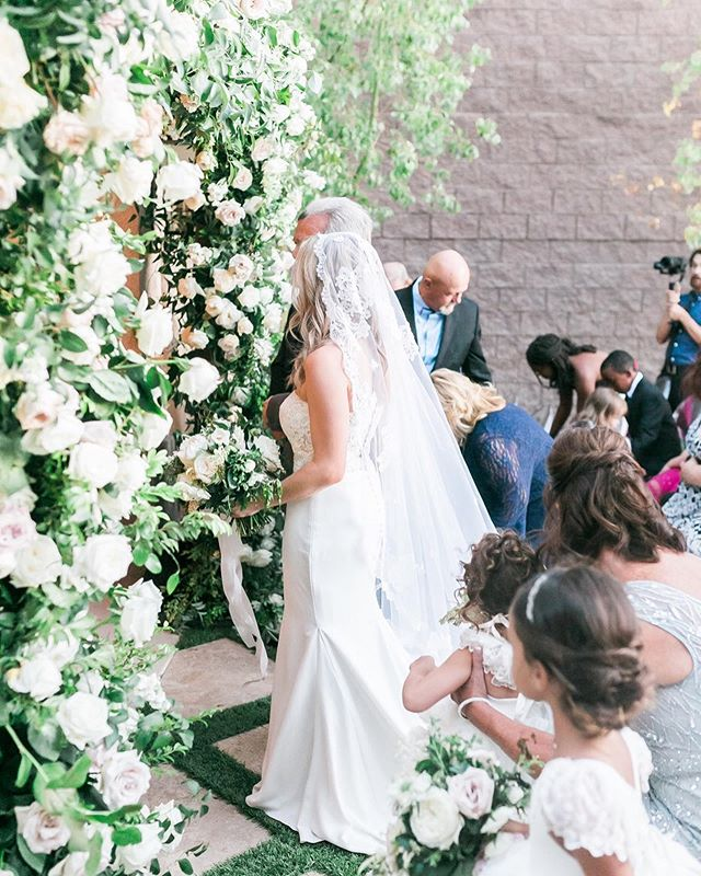 The backyard ceremony around the pool was intimate but still very luxurious.  Photography @j.annephotography.  Rentals @rsvppartyrentals & @freshwata.  Lighting @ledunplugged.  Hair and Makeup @yourbeautycall