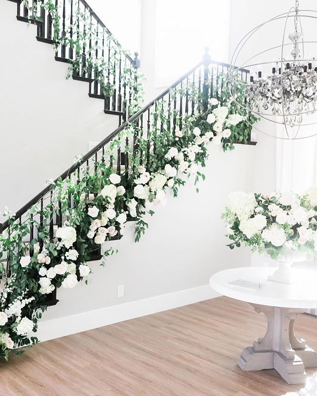 The stairway in the couple's home needed its own special moment and was one of my favorite elements of the wedding.  Photography @j.annephotography.  Rentals @rsvppartyrentals & @freshwata.  Lighting @ledunplugged.  Hair and Makeup @yourbeautycall