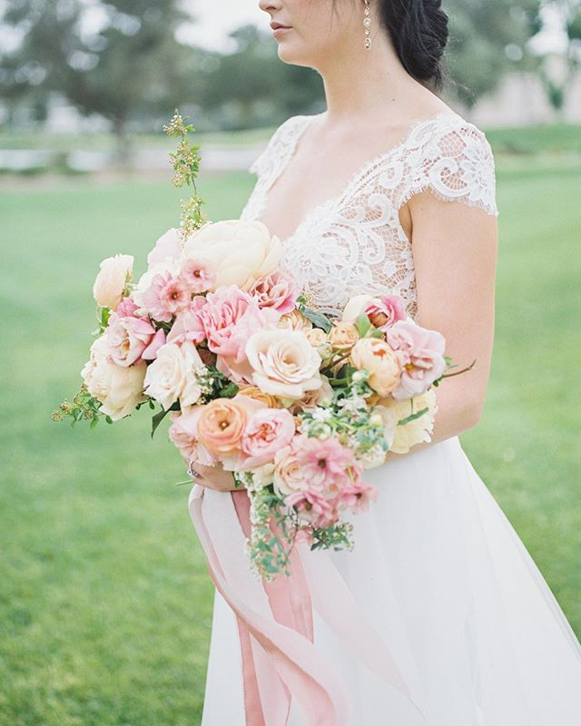 We had the opportunity to create some beautiful florals inspired by the 2019 Pantone color of the year, Living Coral. Working with all of the juicy colors and blooms as well as the incredibly vendor team was a lot of fun.  Planner: @idodetailslv  Photography: @liannamariephoto  Venue: @lasvegascountryclub  Floral: @layersoflovely  Bridal Gown: @anaisanette from @greypearlbride  Tuxedo: @mastroiannifashions  Ring: @tbirdjewels Bridesmaids Dresses: @jennyyoonyc from @bellabridesmaids  Hair & Makeup: @paperbagbeauty