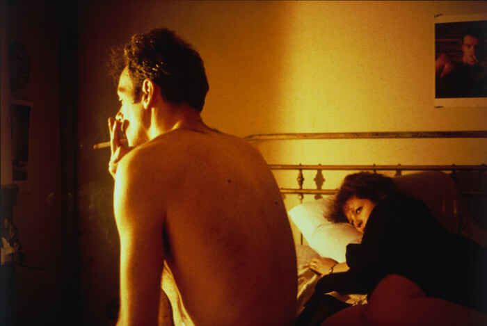 Nan and Brian in Bed, New York City. 1983. Silver dye bleach print, printed 2006, 15 1/2 x 23 3/16″ (39.4 x 58.9 cm). The Museum of Modern Art, New York. Acquired through the generosity of Jon L. Stryker. (C) 2016 Nan Goldin